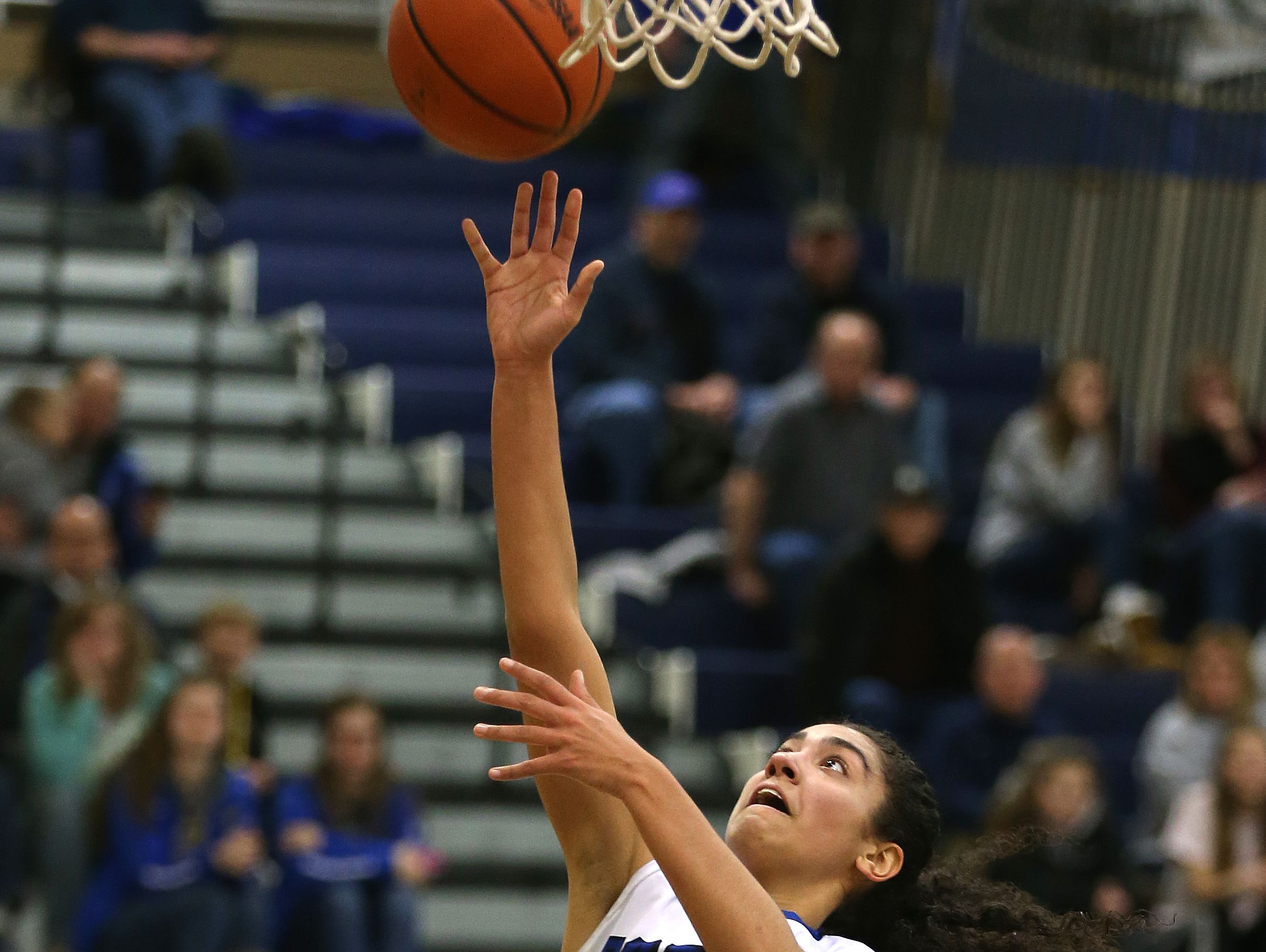 Batavia's Tiara Filbert drives to the basket .
