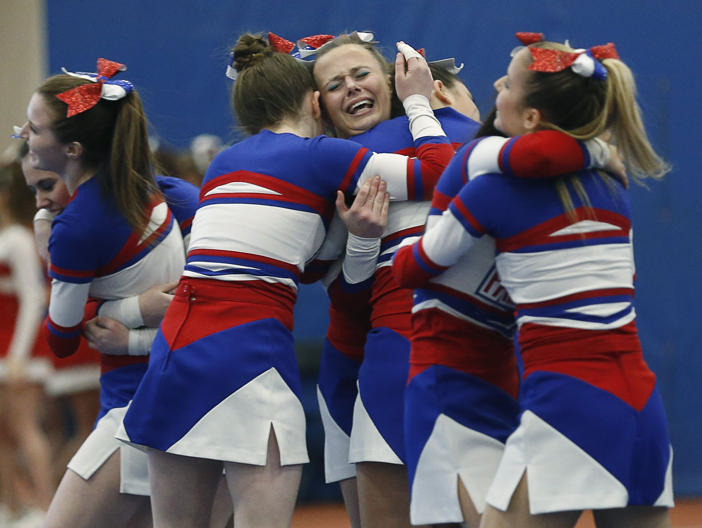 Fairport's Kaela Lush celebrates its Division 1-Large performance, which the Red Raiders won at the Section V High School Winter Cheerleading Championships at RIT on Feb. 27, 2019.
