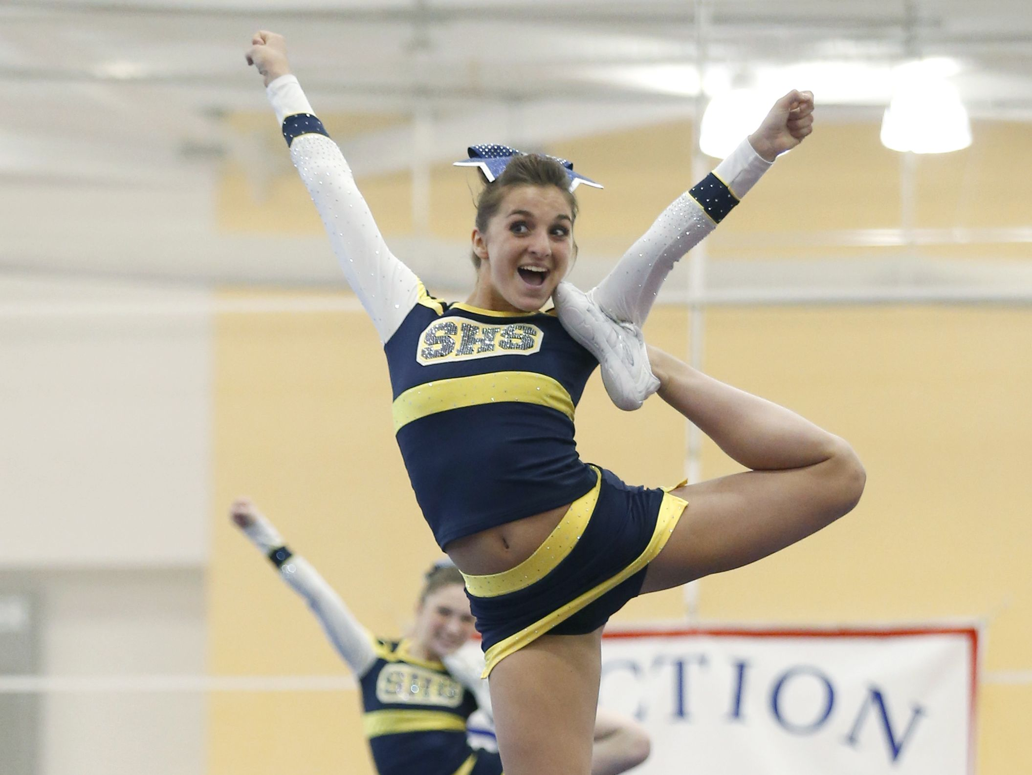 Spencerport lifts Taylor Pohleven in Division 1-Large competition.