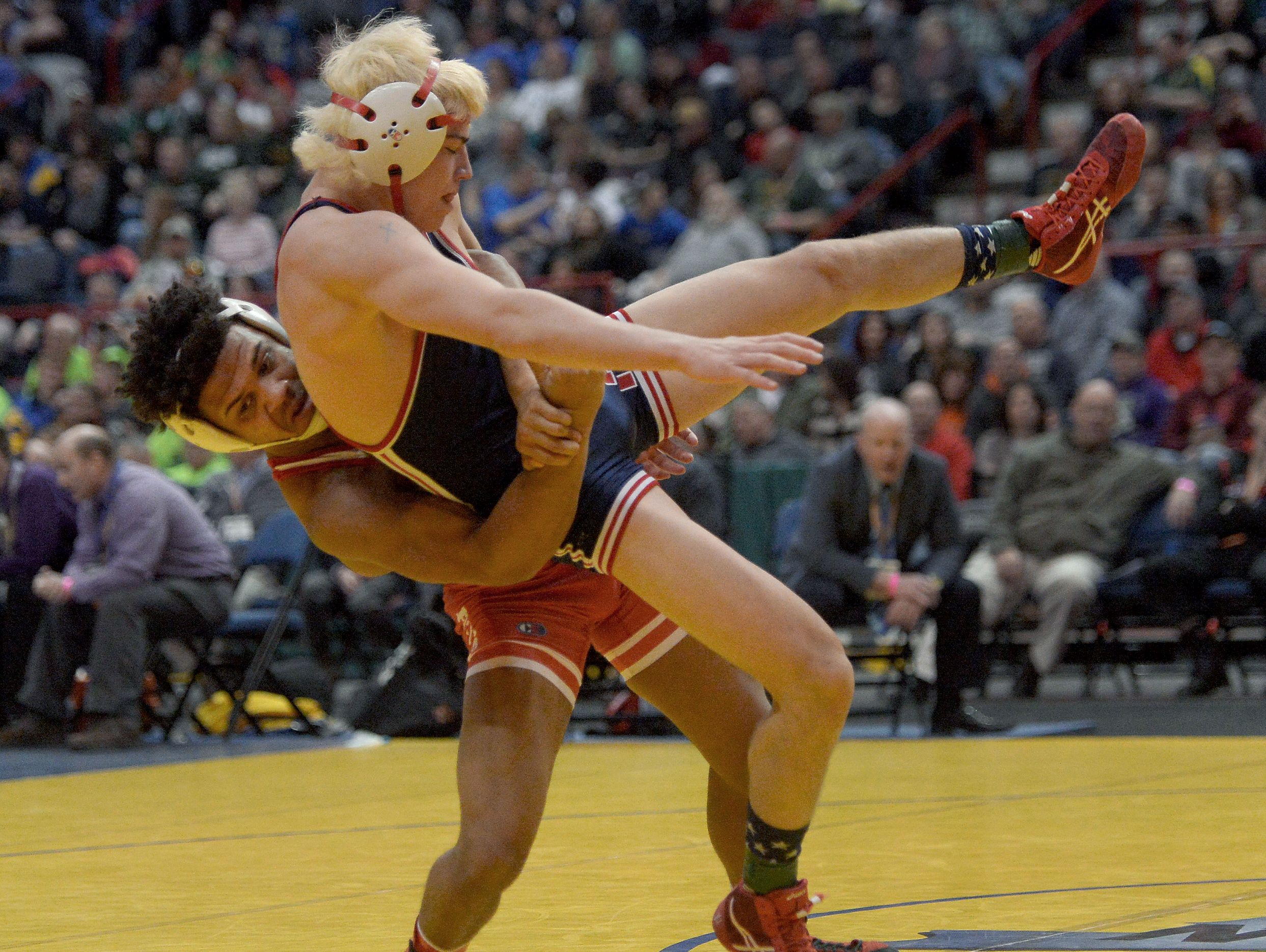 Penfield's Frankie Gissendanner, left, wrestling North Tonawanda's Troy Keller in the 2016 Division I state finals of the 145-pound class.