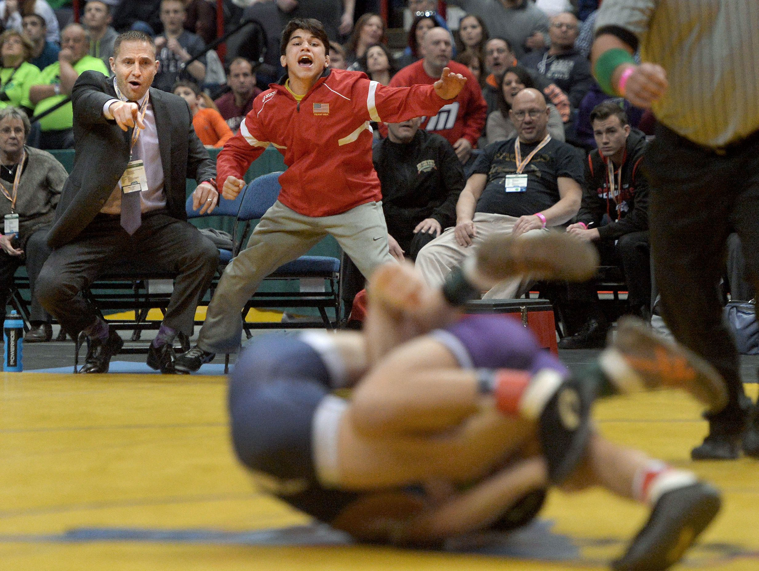 Hilton coach Craig Gross, left, and Yianni Diakomihalis cheer on Greg Diakomihalis in the finals of the 99-pound class (Division I)..