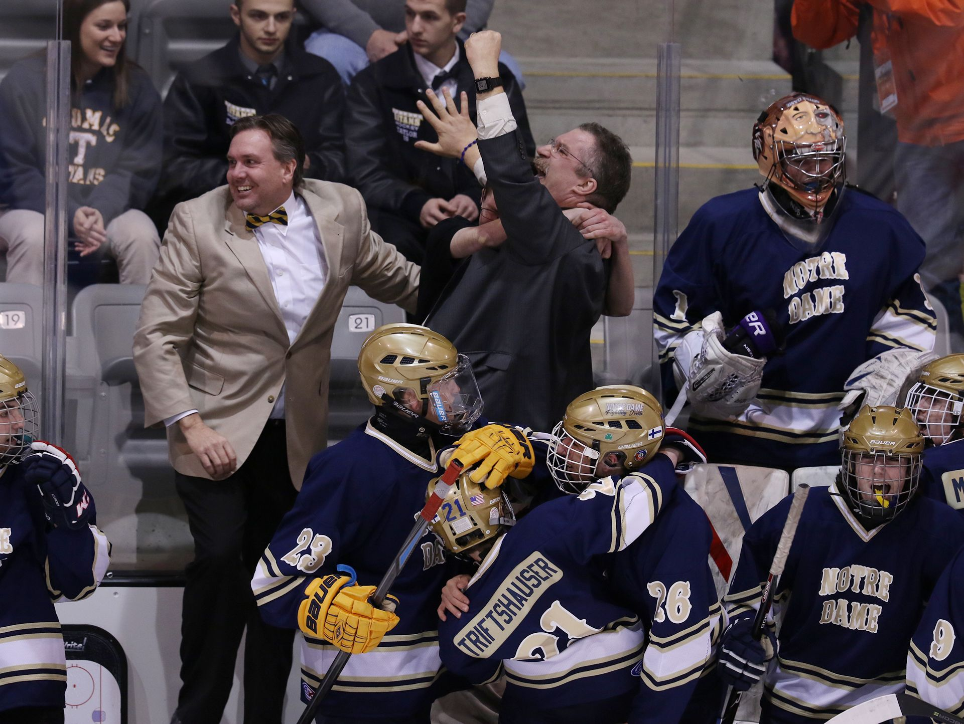 The coaches , including head coach Marc Staley, and the bench of Batavia Notre Dame react as they pull ahead in the final seconds 2-0 against Geneseo/Livonia/Avon.