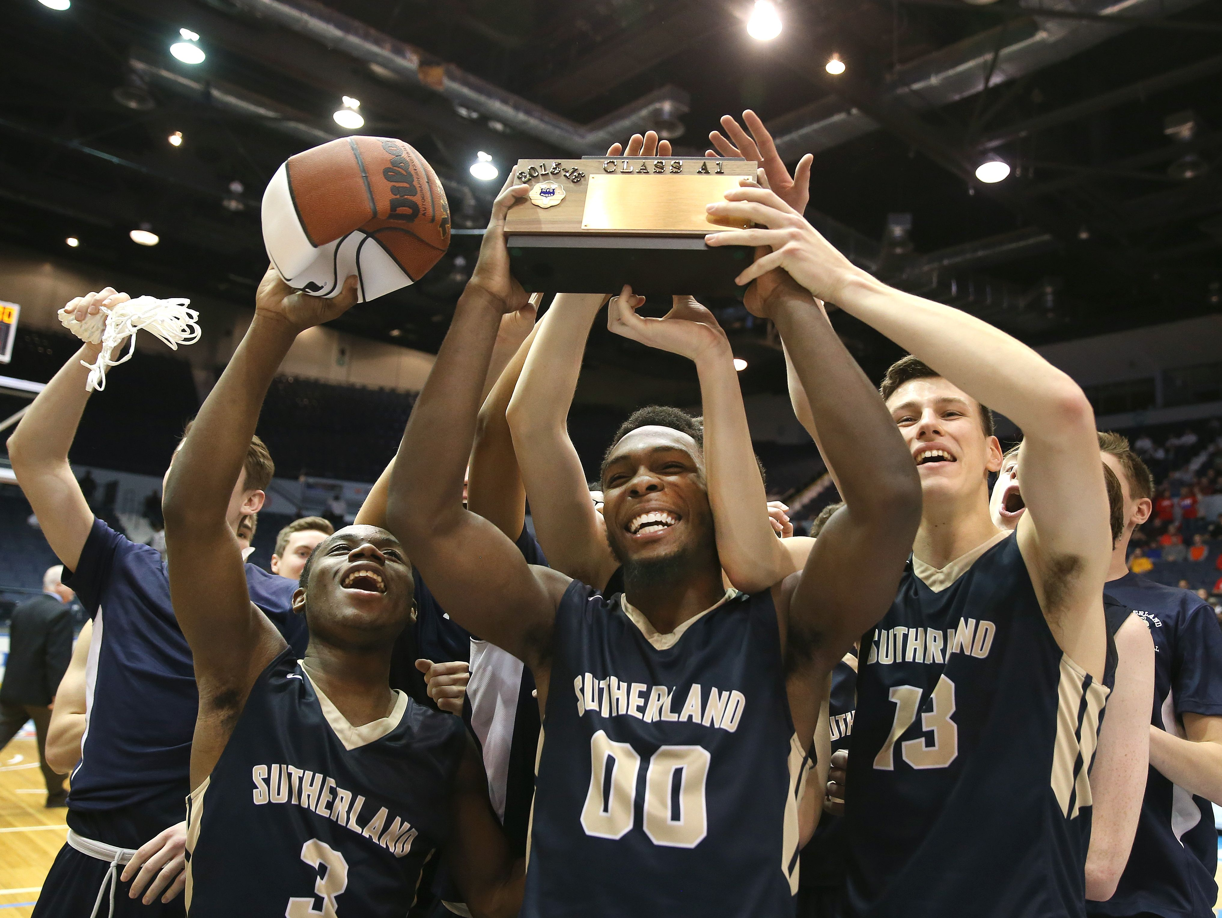 Pittsford Sutherland players celebrate their win over Greece Athena to capture the Class A1 championship.