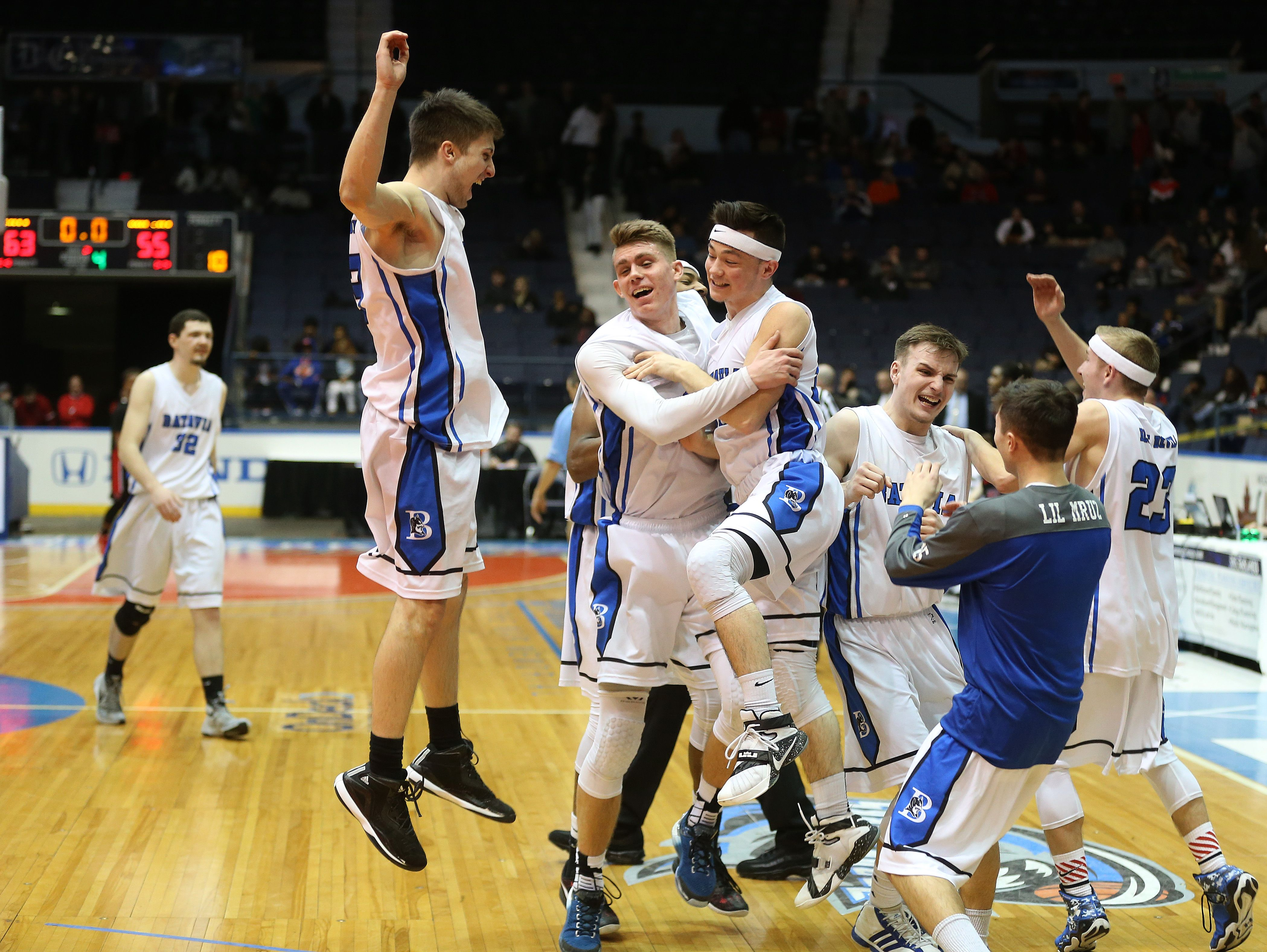 Batavia players celebrate after beating Wilson for the Class A2 championship 64-57.