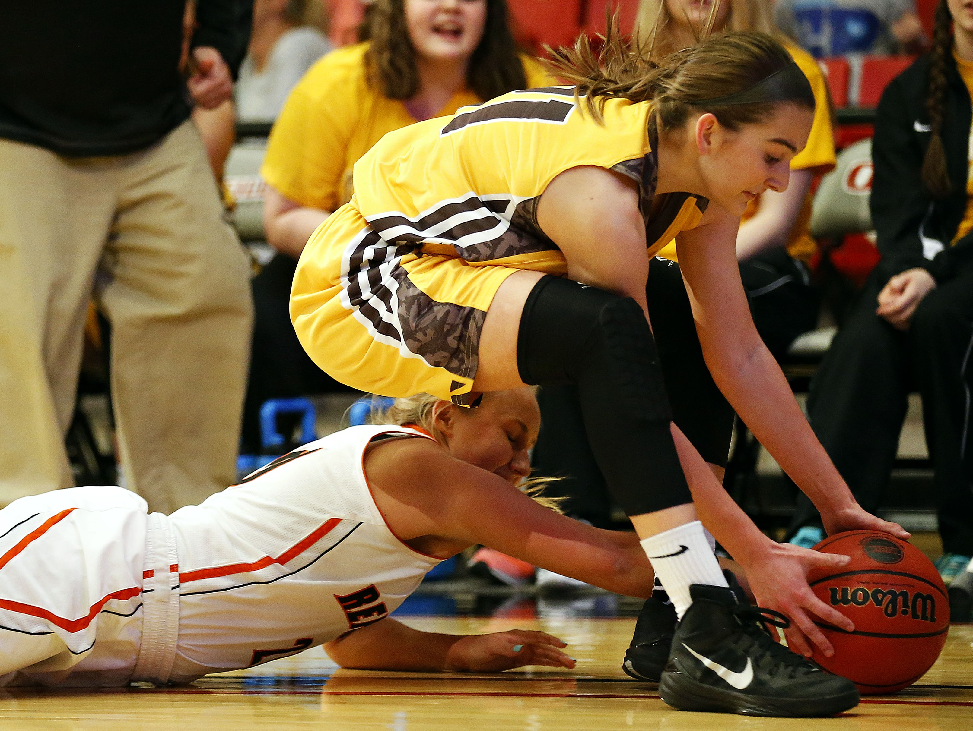 Republic High School guard Alexis Ladwig (20) and Kickapoo High School guard Jordan Wersinger (21) fight for a loose ball during first quarter action of the class 5 sectional playoff game between Republic High School and Kickapoo High School played at the O'Reilly Family Event Center in Springfield, Mo. on March 9, 2016. The Kickapoo Lady Chiefs won the game 81-65.