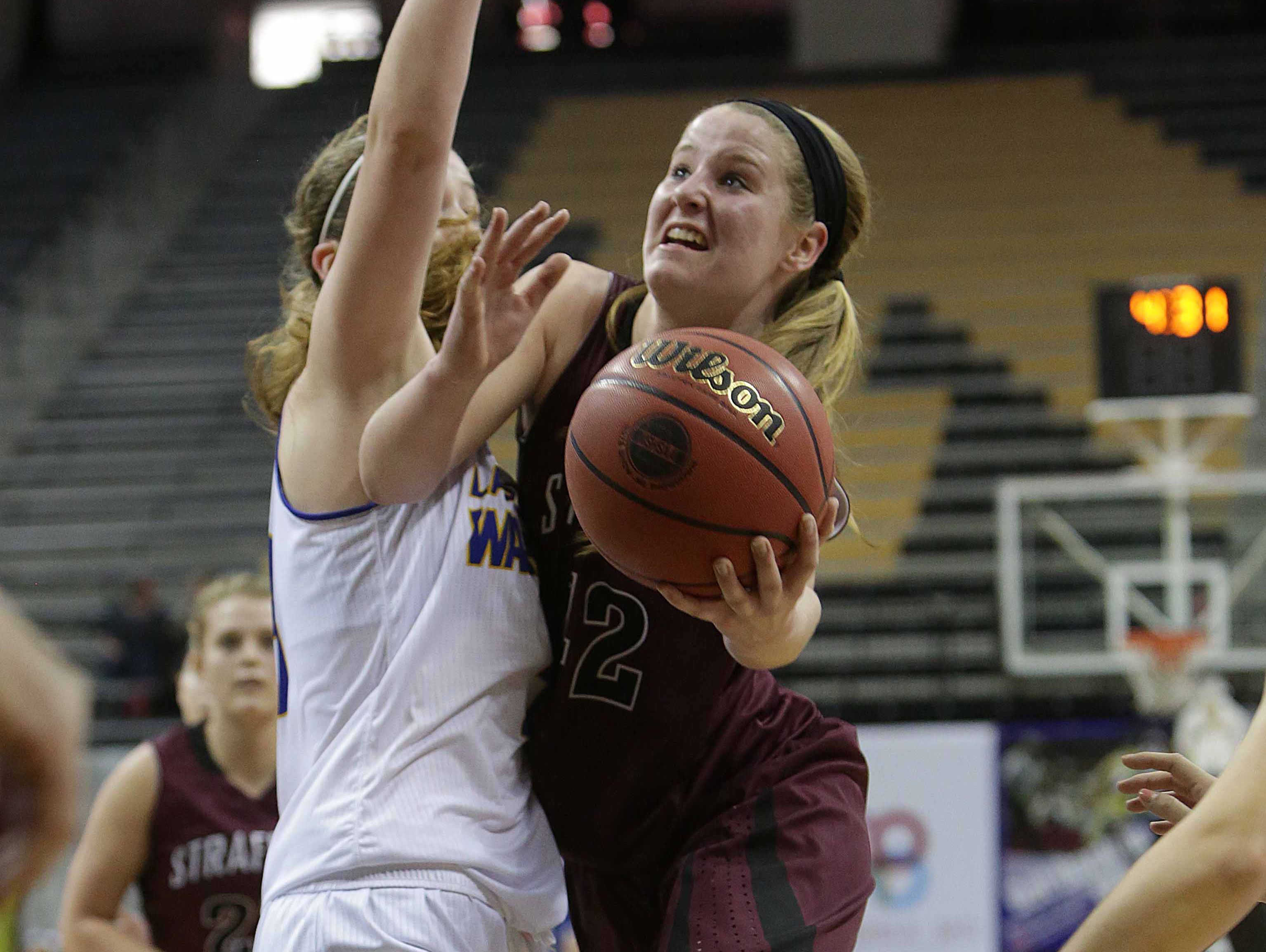 Stafford defeated St. Piux X in the opening round of the state tournament. Strafford's Hayley Frank (42) goes up for a shot as she drives to the basket against St. Pius X's Abigail Hipp. she was fouled on the play.