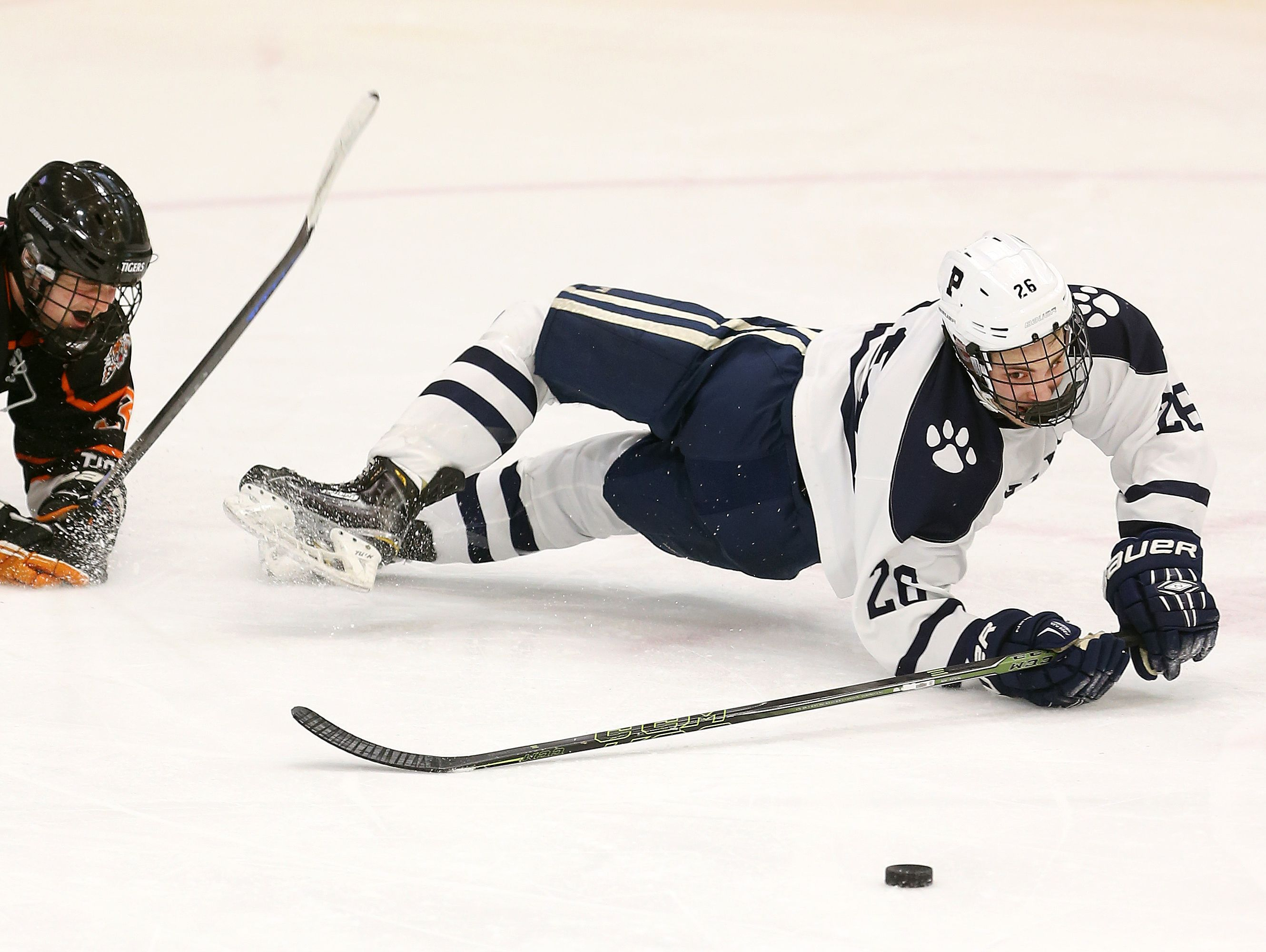 Pittsford's Andy Bronstein is tripped up by Mamaroneck's Kesin Ryan-Dehjia. The Panthers were also tripped up in a 5-2 loss in the state semi-final game.