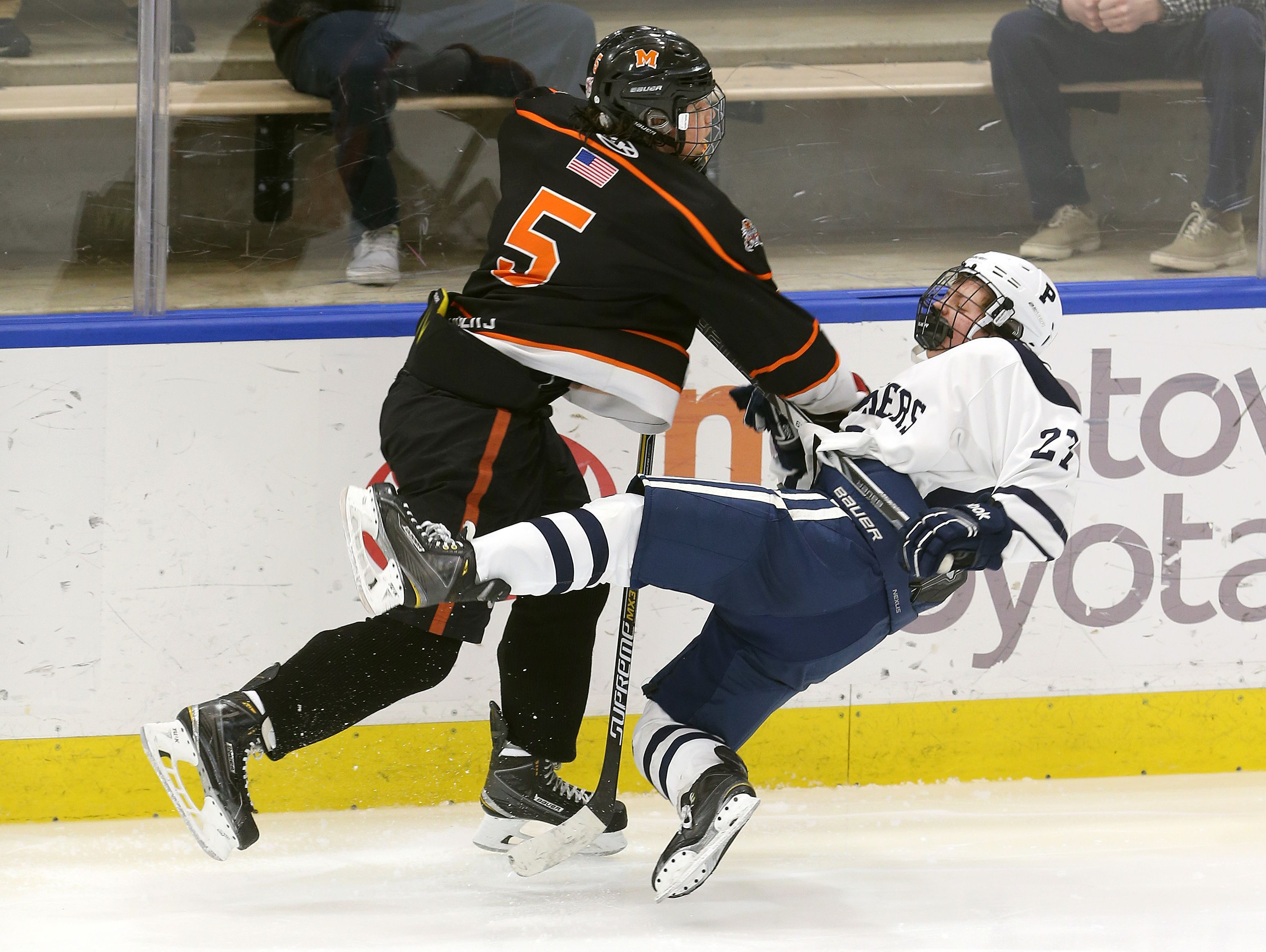 Pittsford's John Mozrall is checked to the ice by Mamaroneck's Jake Levine (5).