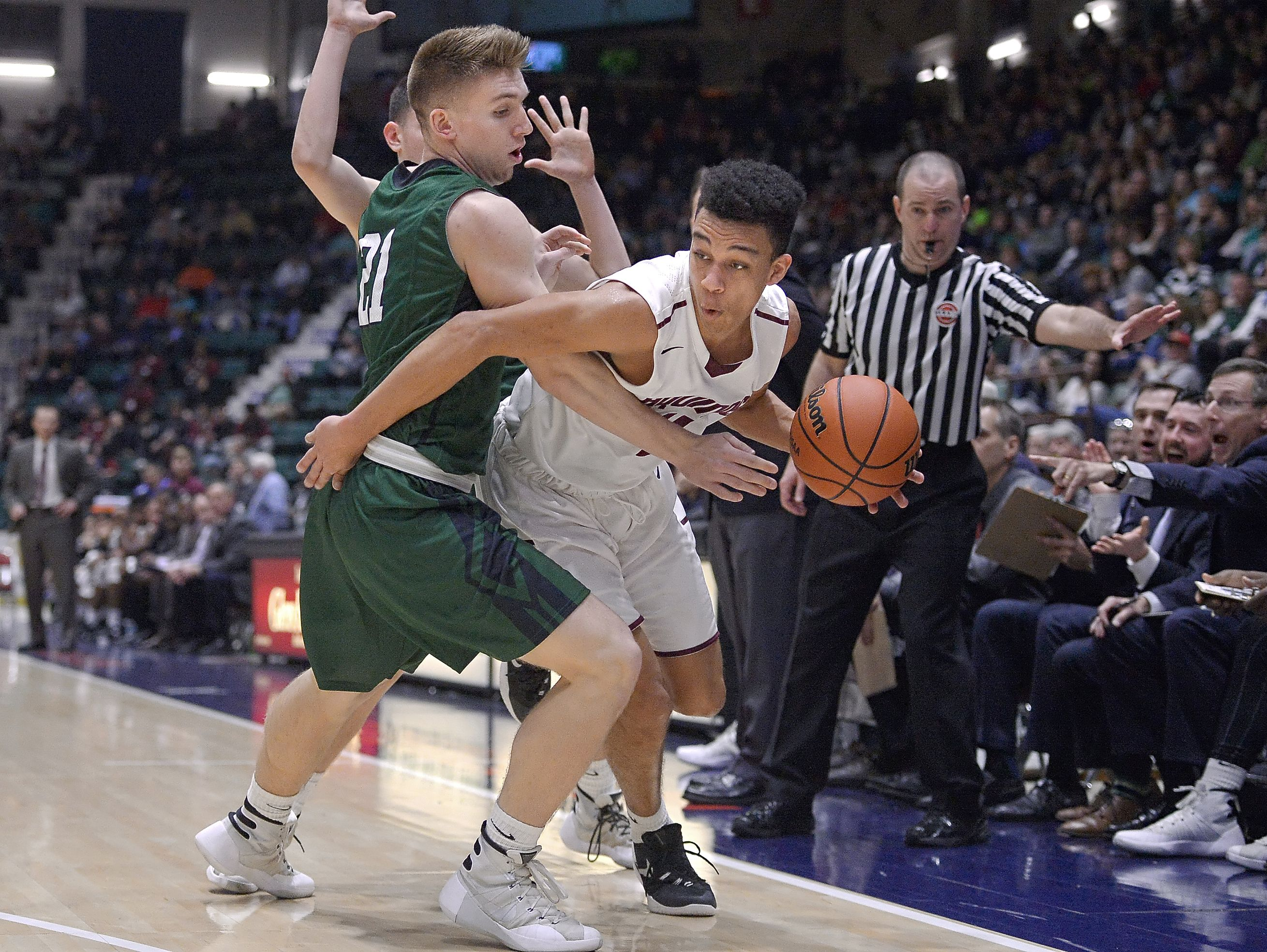 Aquinas' Jason Hawkes, right, moving around Shenendehowa defender Evan Paddock during the NYSPHSAA Class AA state semifinals in Glens Falls.