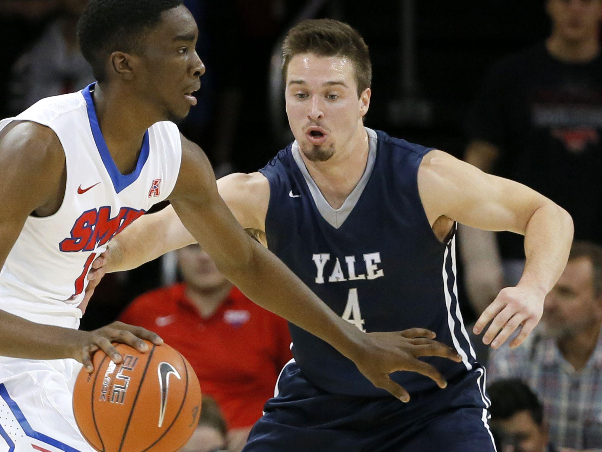 Yale's Jack Montague, right, defends against SMU guard Shake Milton on Nov. 22, 2015.