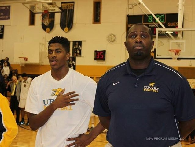 University Preparatory Charter School for Young Men basketball coach James Reaves, right.