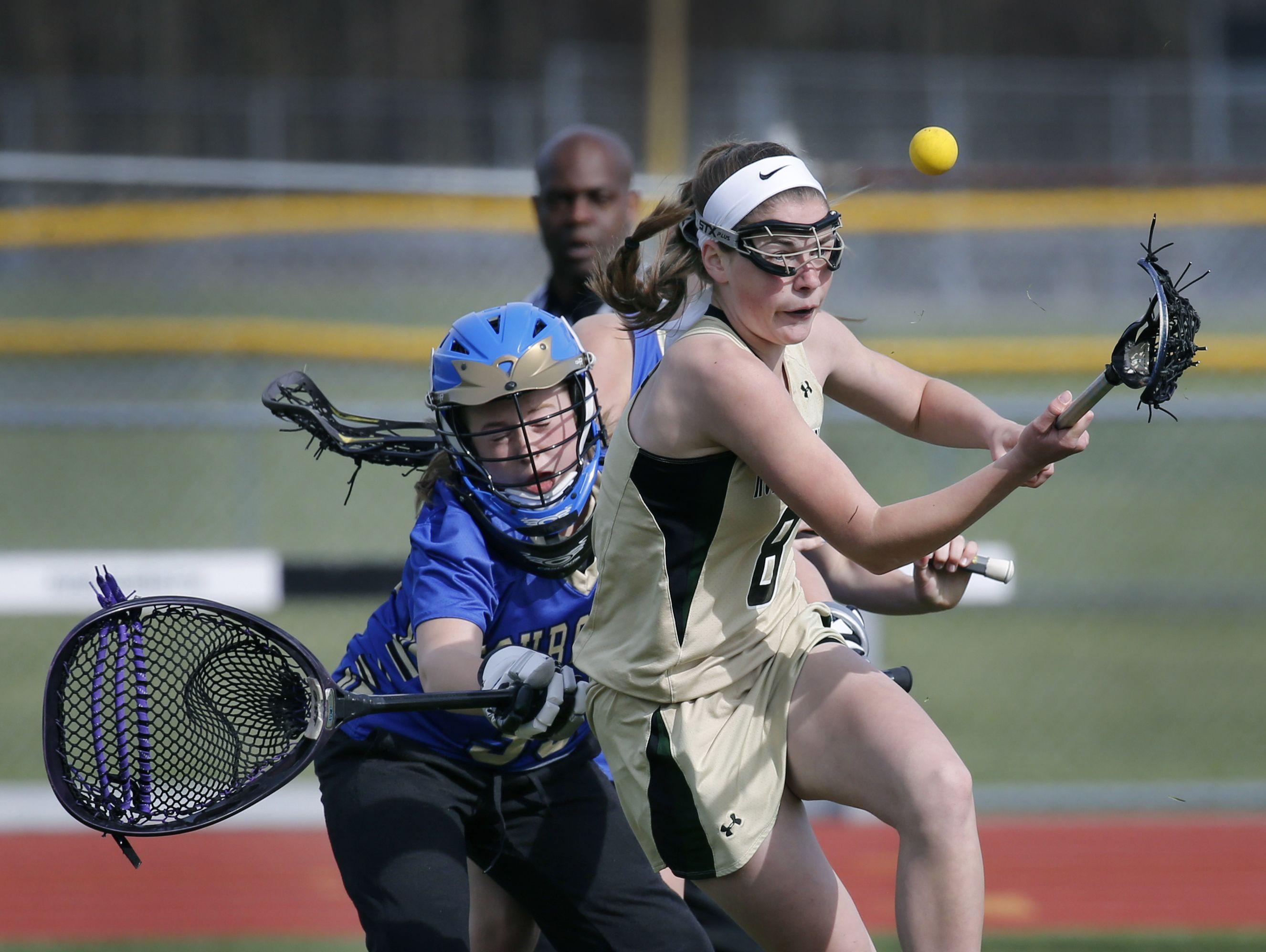 Rush-Henrietta's Rachel Crane controls the ball before scoring for a 2-0 lead against Webster Schroeder goalie Jorden Concordia in the first half at Rush-Henrietta High School.