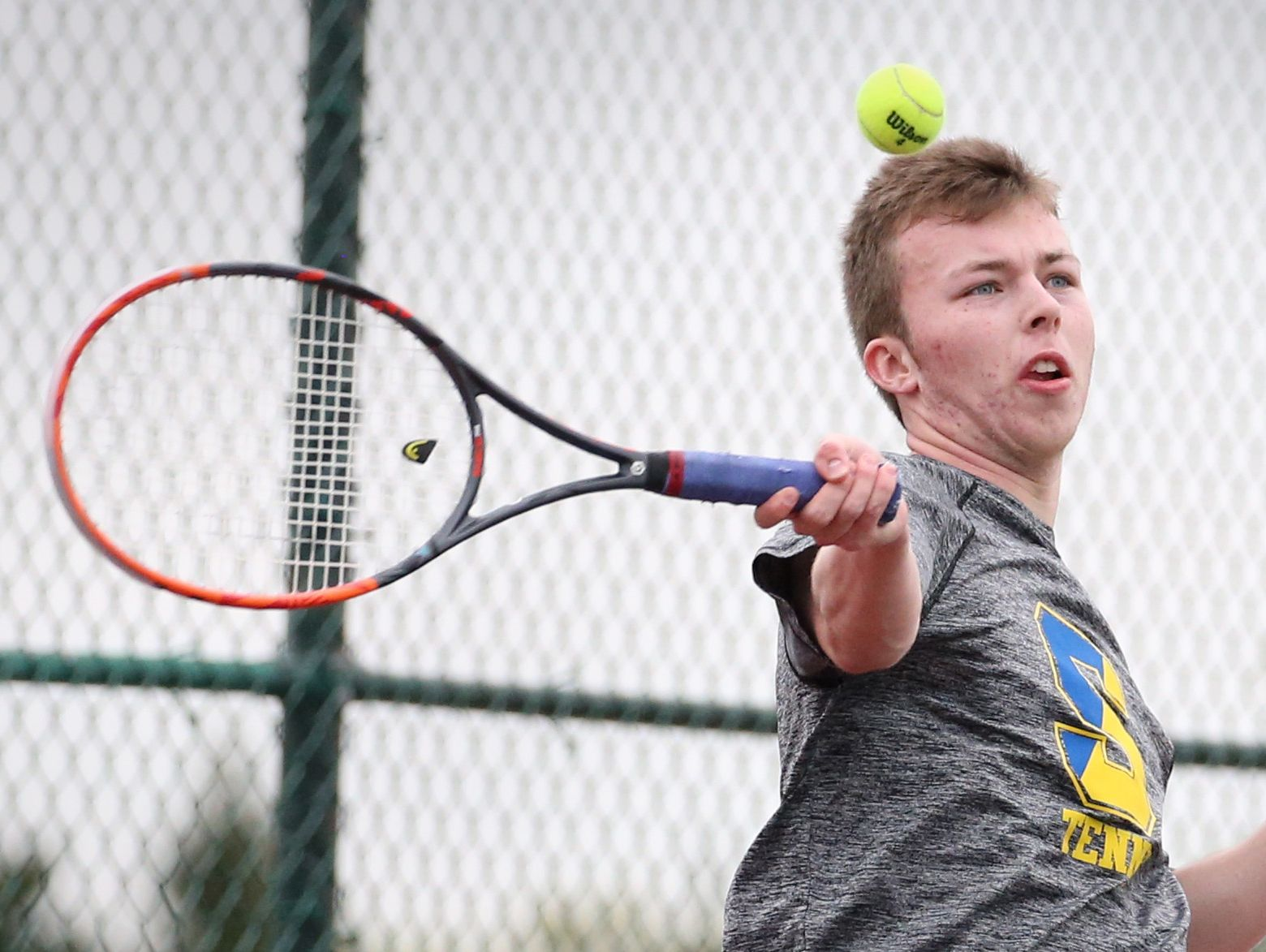 Webster Schroeder's Matt Gamble rips a forehand during his opening match against Geneva's Ryan Fishback during the Section V boys tennis state qualifier Saturday, May 21, 2016 at Pittsford Mendon High School. Gamble won the match, and went on to win the singles finals.