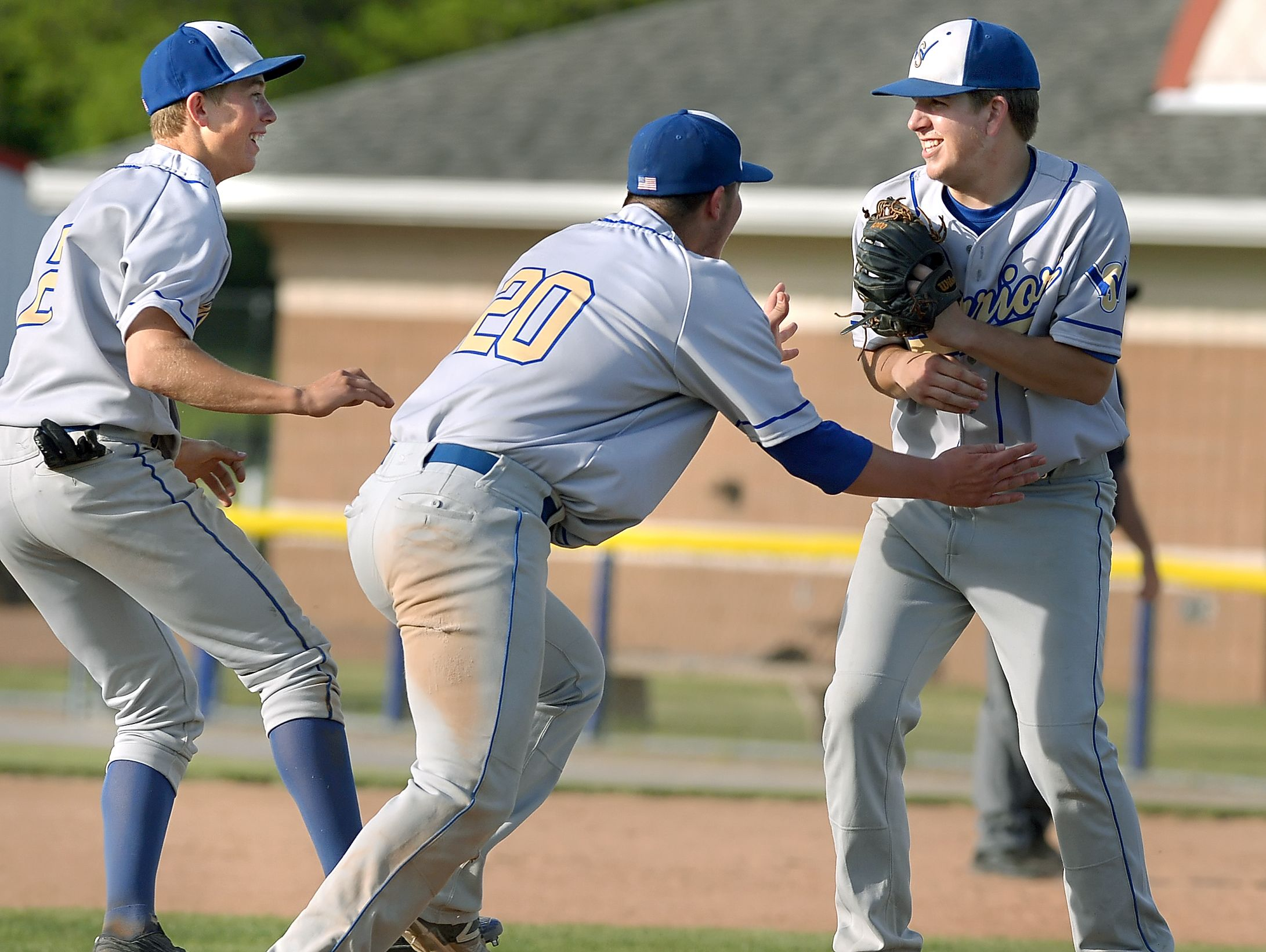 Webster Schroeder's Justin Graham, left, and Phil Ferranti charge pitcher Nick Lawlor after the final out during the Section 5 Class AA Sectional Championship played at Dwyer Stadium in Batavia on May 27, 2016. Webster Schroeder claimed the Class AA title with a 14-0 win over East High.