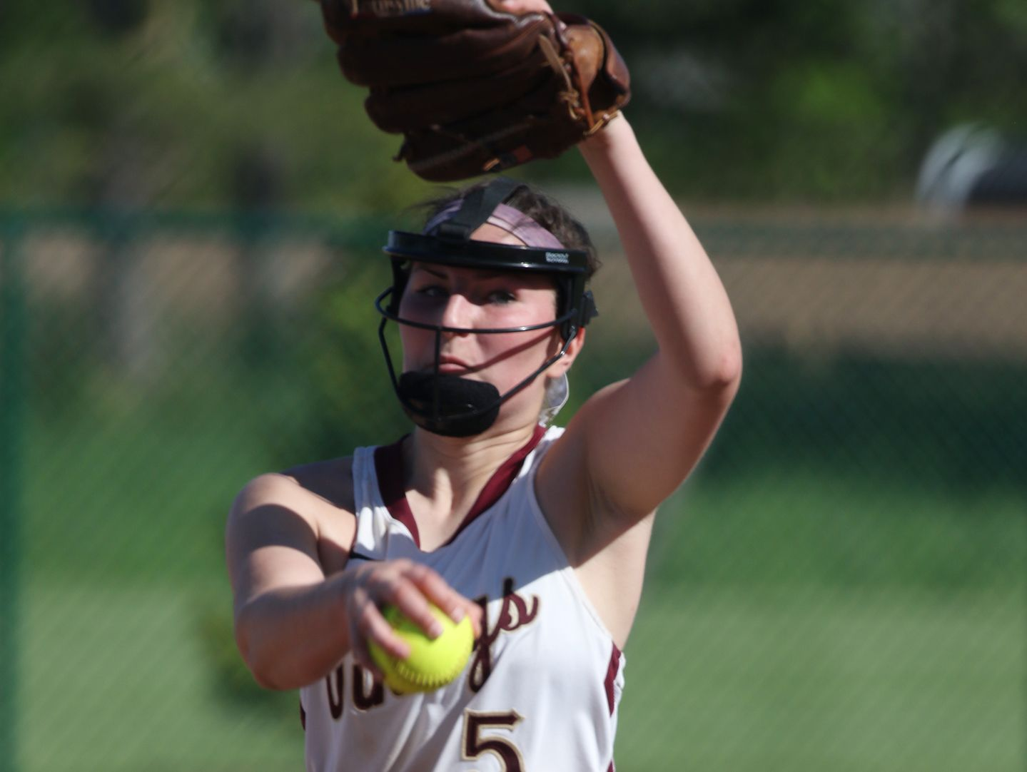 Pittsford Mendon's pitcher Taryn Welch winds up.