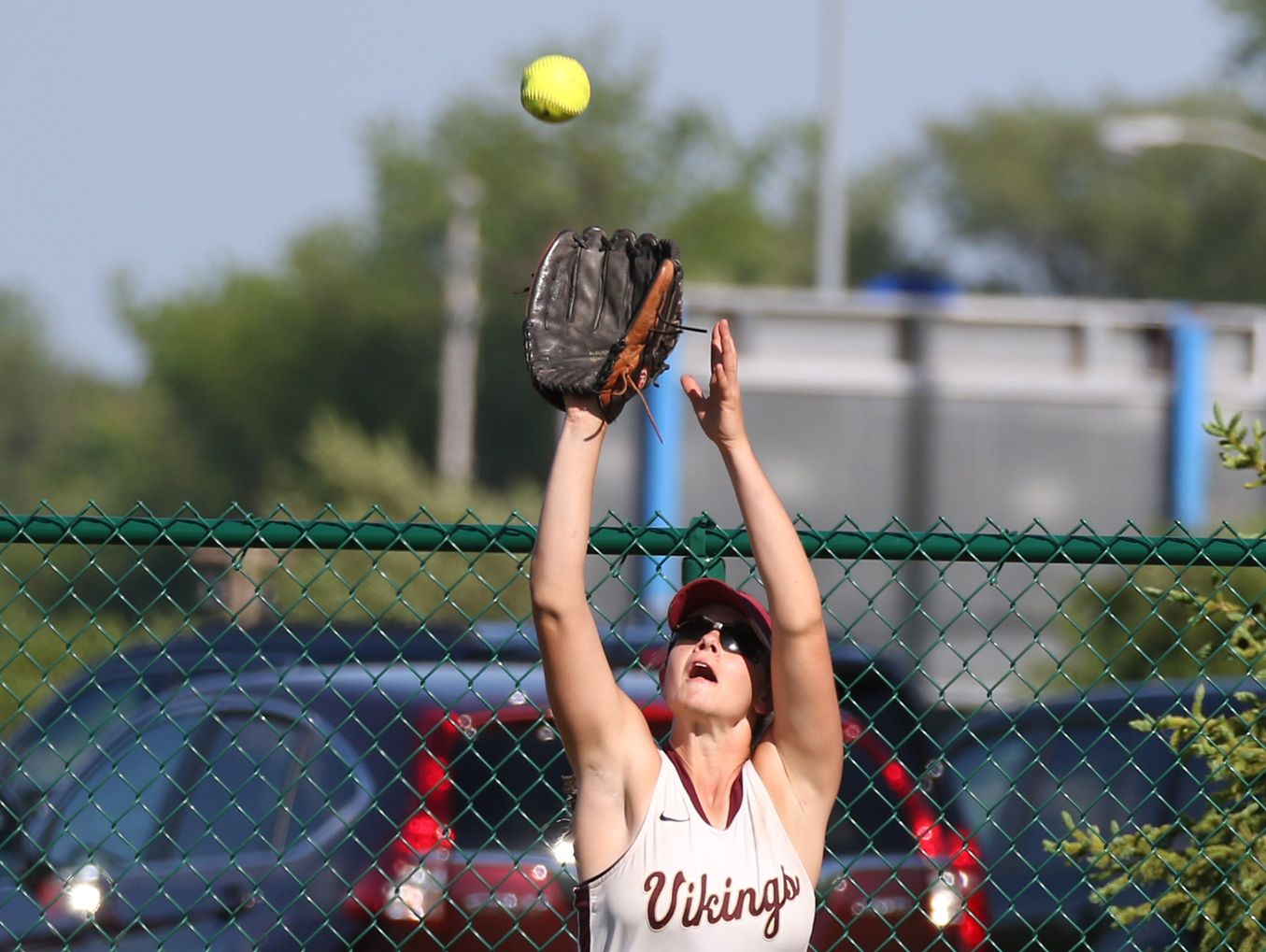 Pittsford Mendon's Sara Lyons catches a flyout in center field.