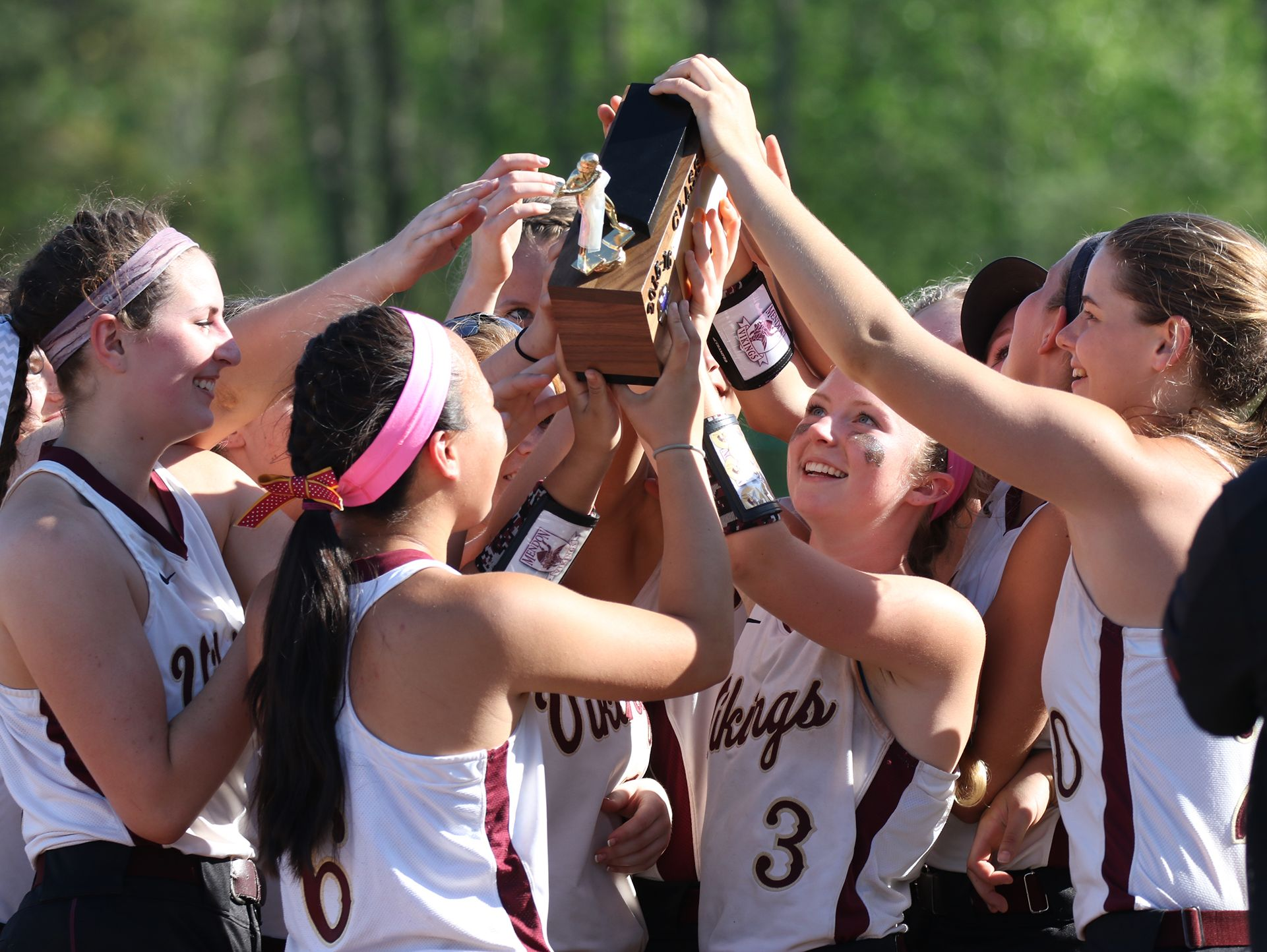 The Pittsford Mendon team holds its trophy to celebrate the Class A championship at The College at Brockport on May 27, 2016.