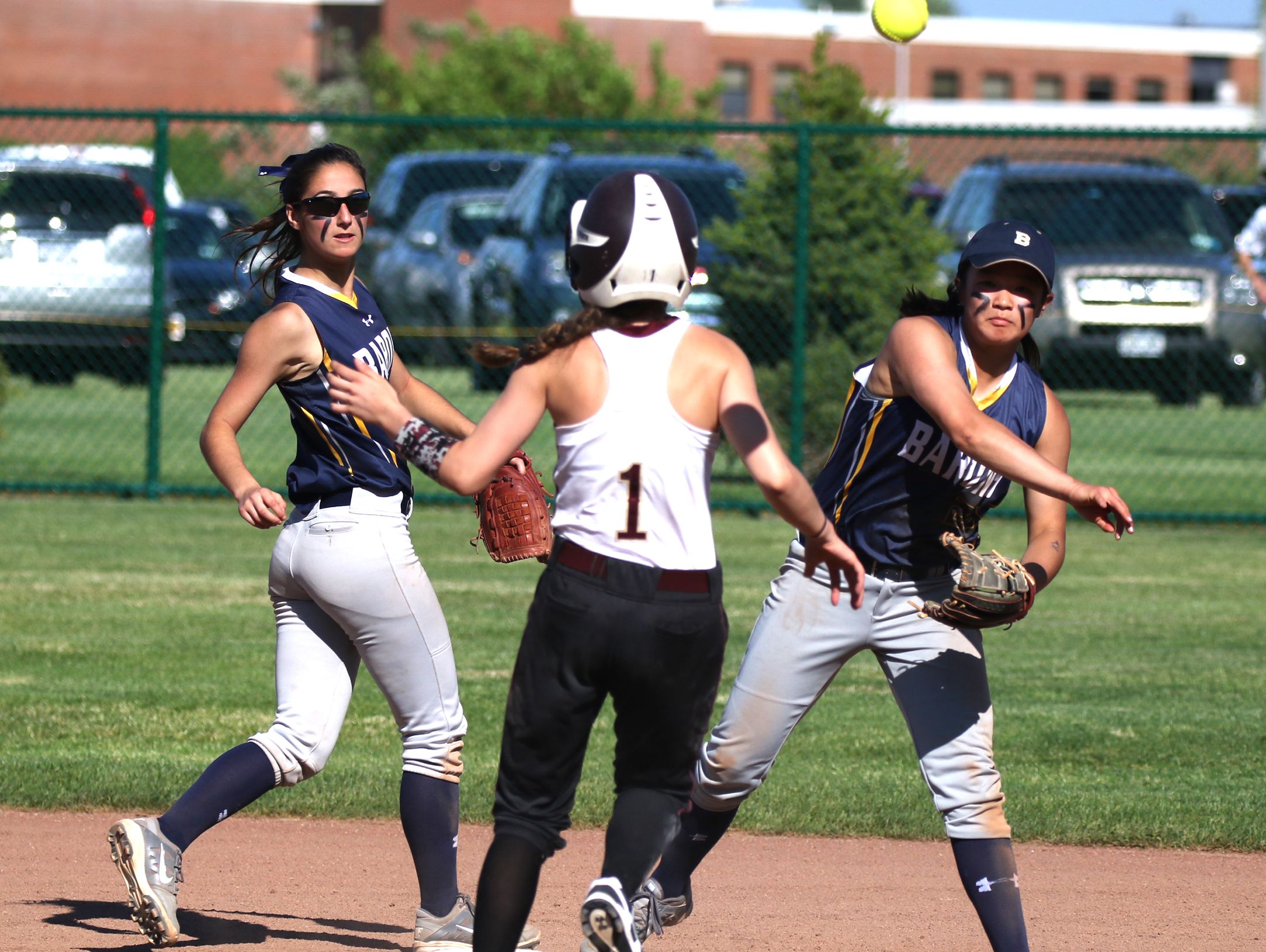 Brighton's Eliza Demers gets Pittsford Mendon's Leah Montione out at second and throws to first to complete a double play.
