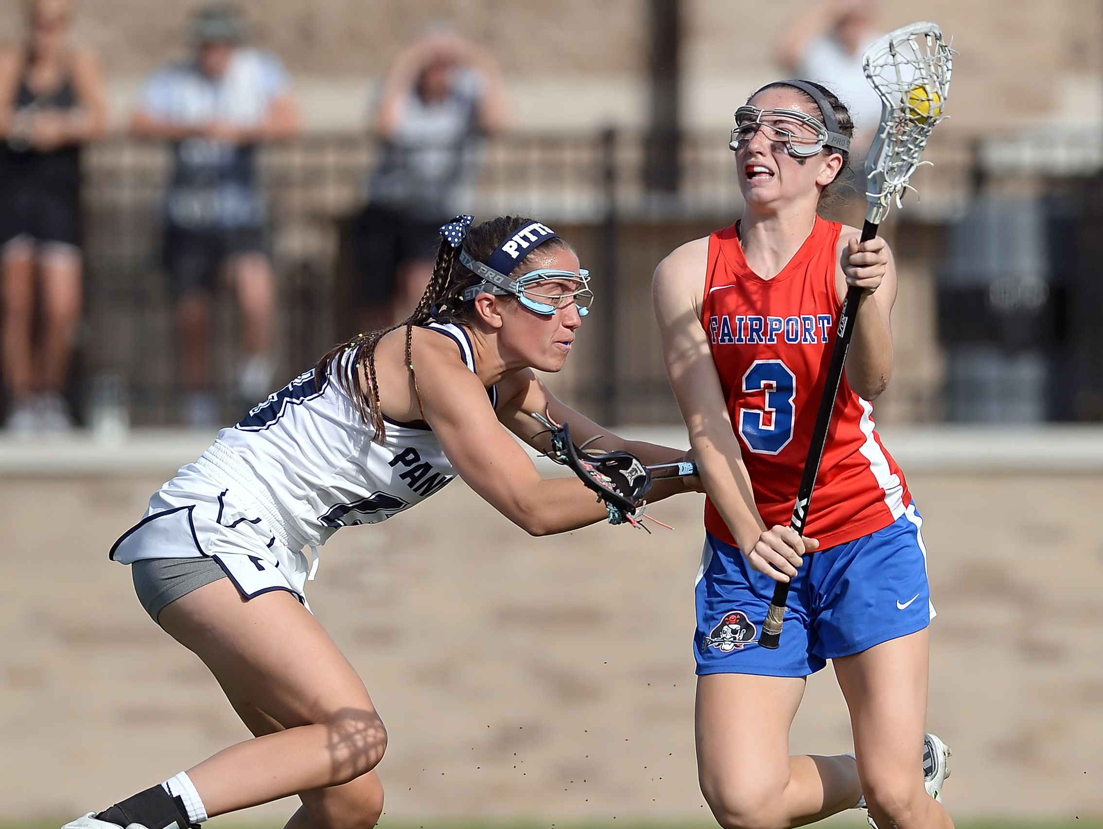 Fairport's Maddie Howe, right, is defended by Pittsford's Caroline Cullinan during the Section V Class A Girls Lacrosse Championship played at St. John Fisher College on Tuesday, May 31, 2016.