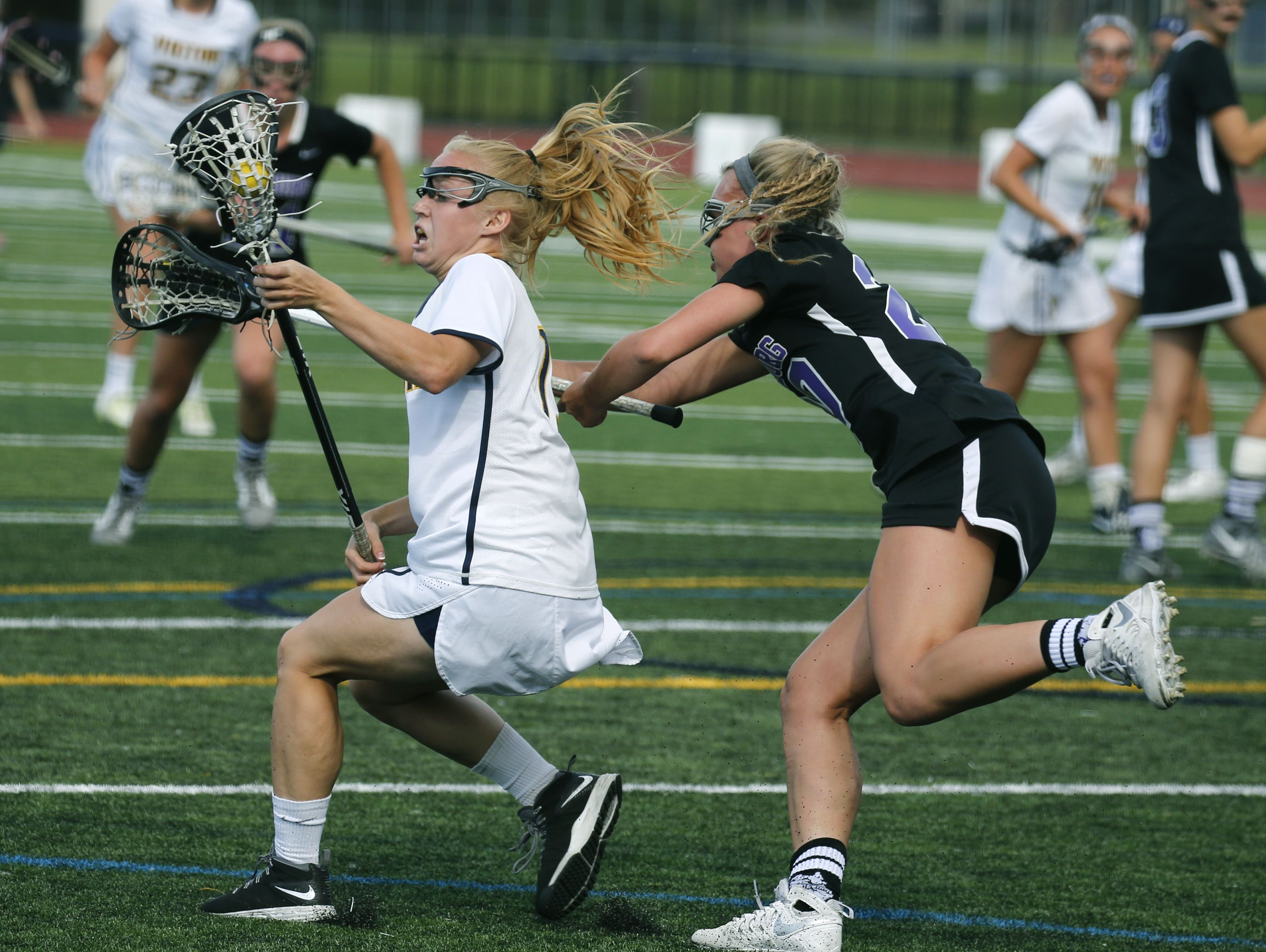 Victor's Kaci Messier under pressure from Hamburg's Julia Feuerstein in the first half at Pittsford Sutherland High School.
