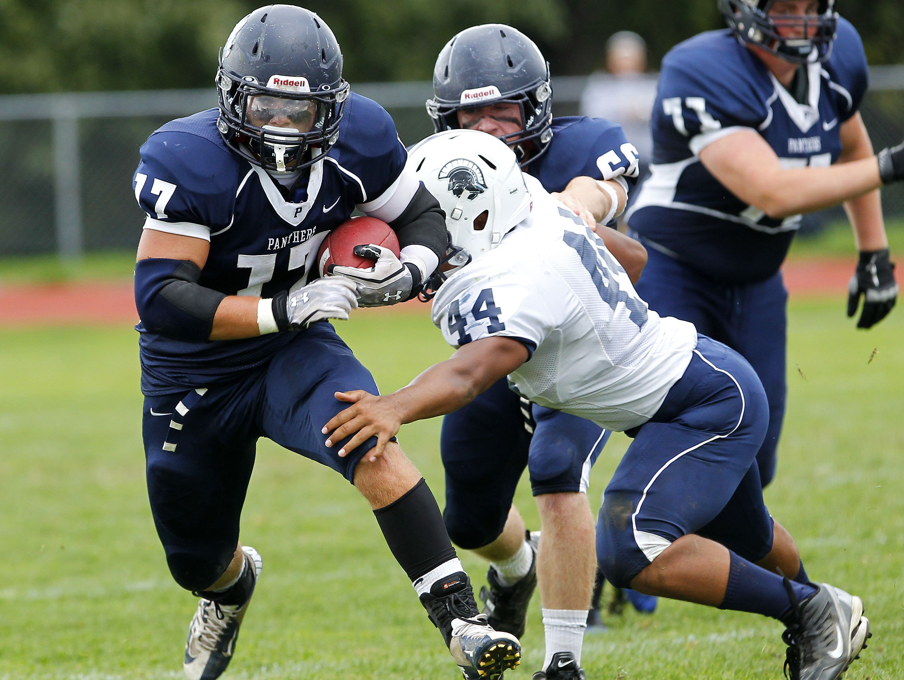 Pittsford's Glynn Molinich, left, rushed for a career-best 172 yards in a game against Gates Chili in 2015.