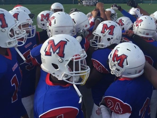 The 2015 Monroe JV football team before a game at Sahlen's Stadium in Rochester.