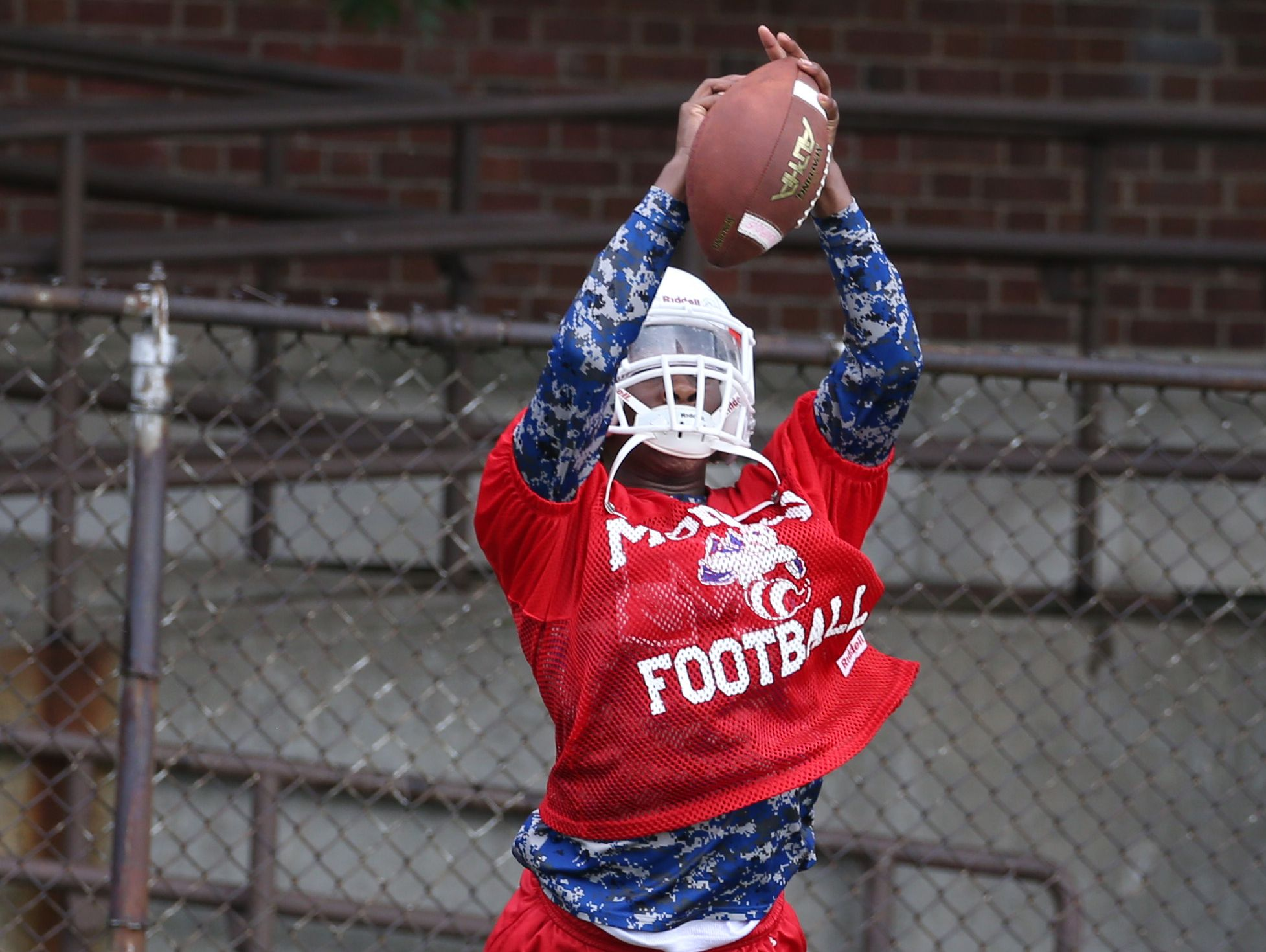 Monroe's Rayshawn Boswell pulls in a pass during coverage drills during varsity football practice at All City High on Ridgeway Avenue in Rochester Tuesday, Aug. 16, 2016.