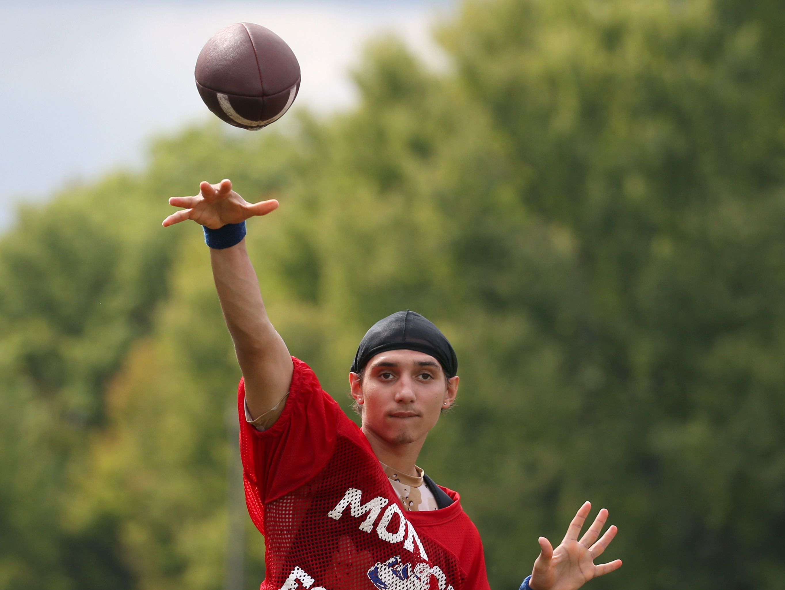Monroe quarterback Anthony Colon airs it out during varsity football practice at All City High on Ridgeway Avenue in Rochester Tuesday, Aug. 16, 2016.