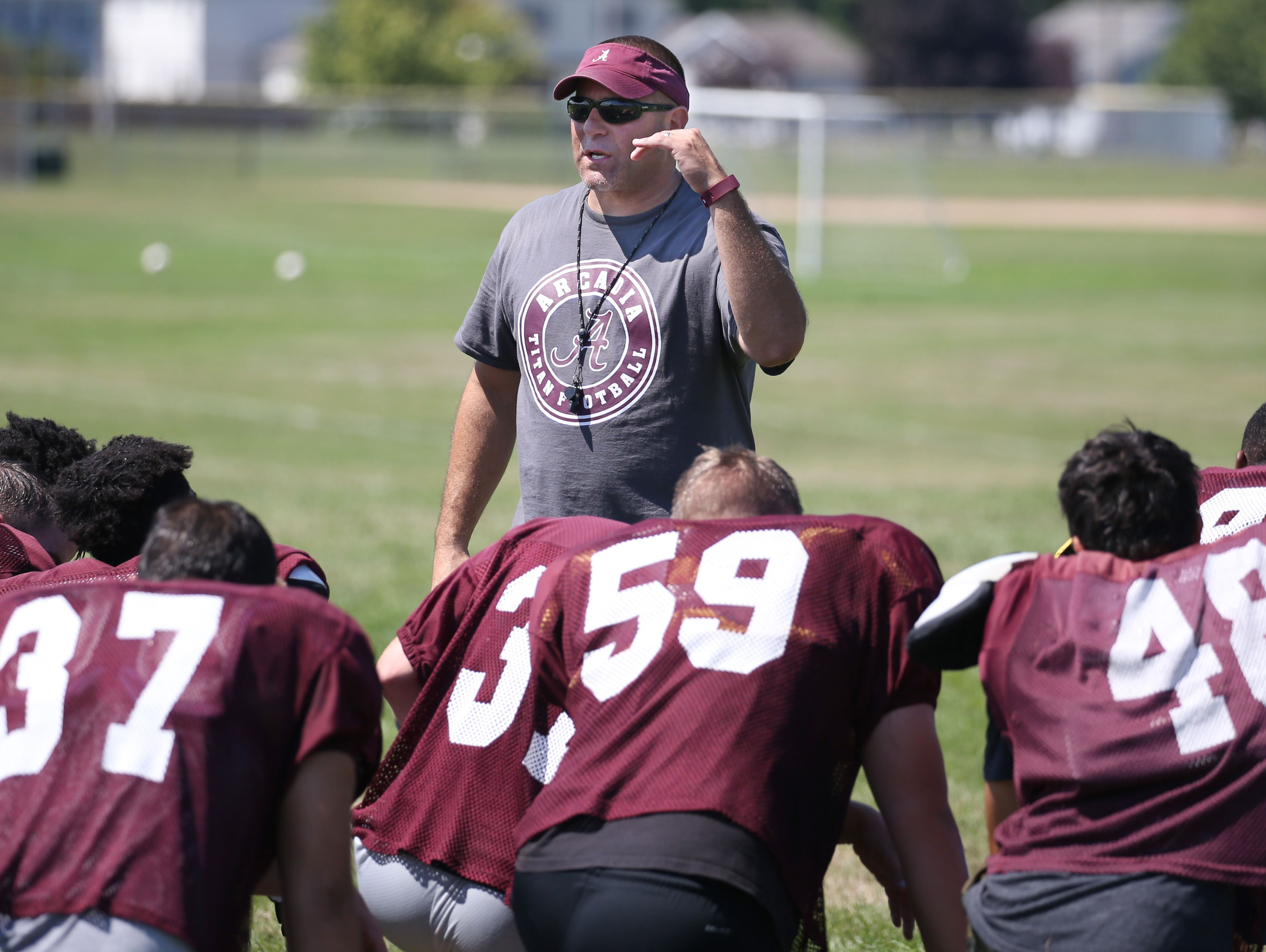 Greece Arcadia head coach John Lockhart keeps his kids motivated during their practice Thursday, Aug. 18, 2016 at the high school in Greece.