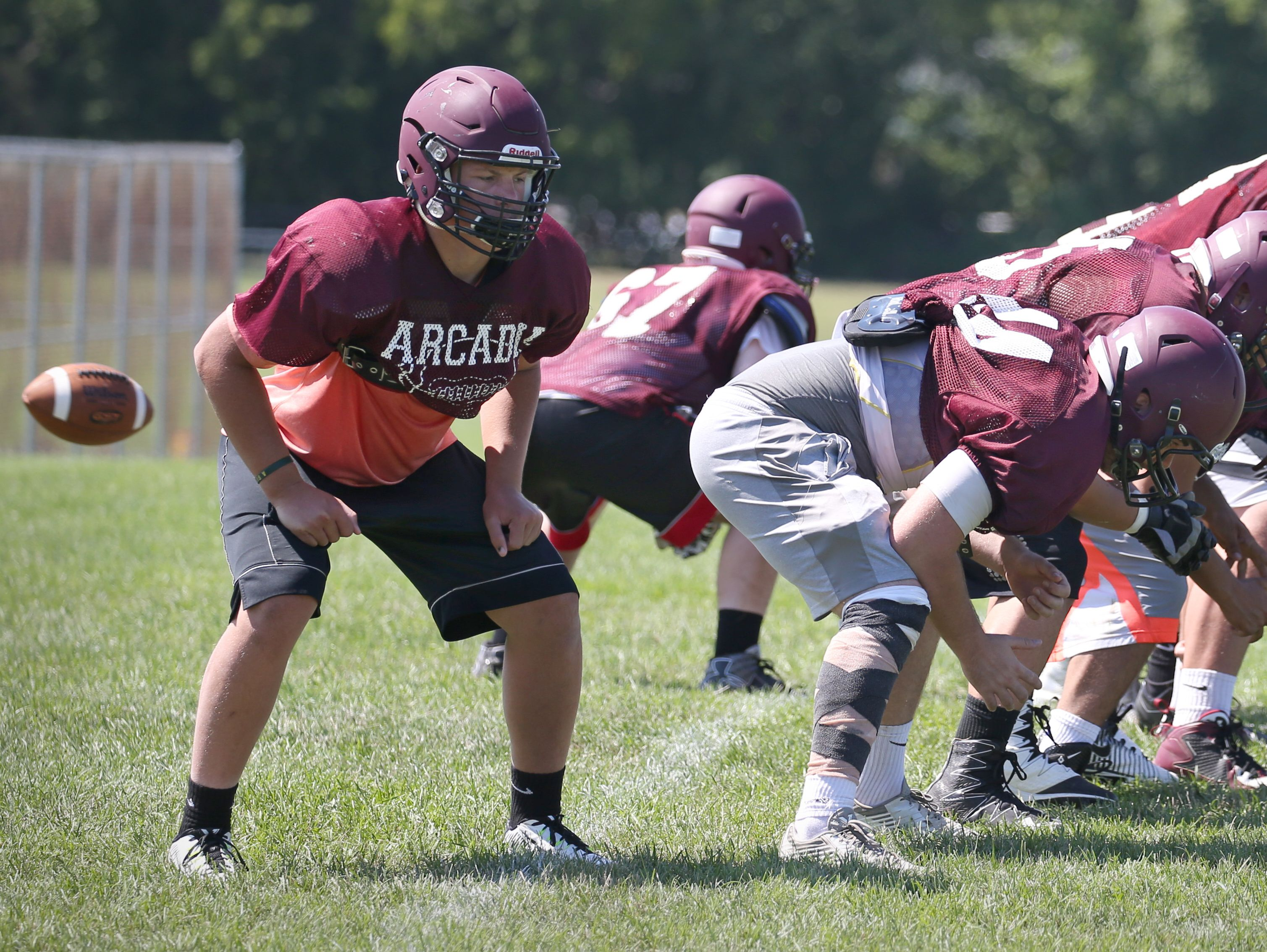 Greece Arcadia fullback and linebacker Nick St. Clair, far left, holds the end of the line during punt formations during their practice Thursday, Aug. 18, 2016 at the high school in Greece.