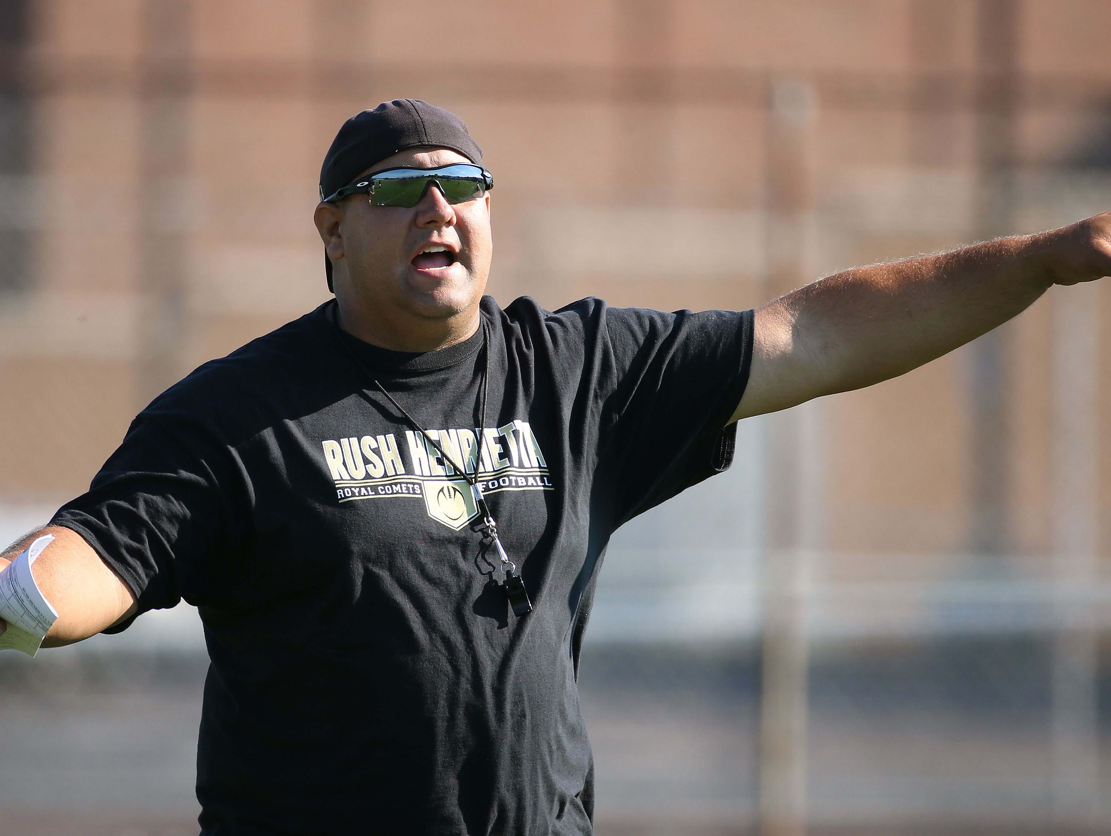 New Rush-Henrietta head coach Jason Collins runs a preseason practice, Wednesday, Aug. 24, 2016.