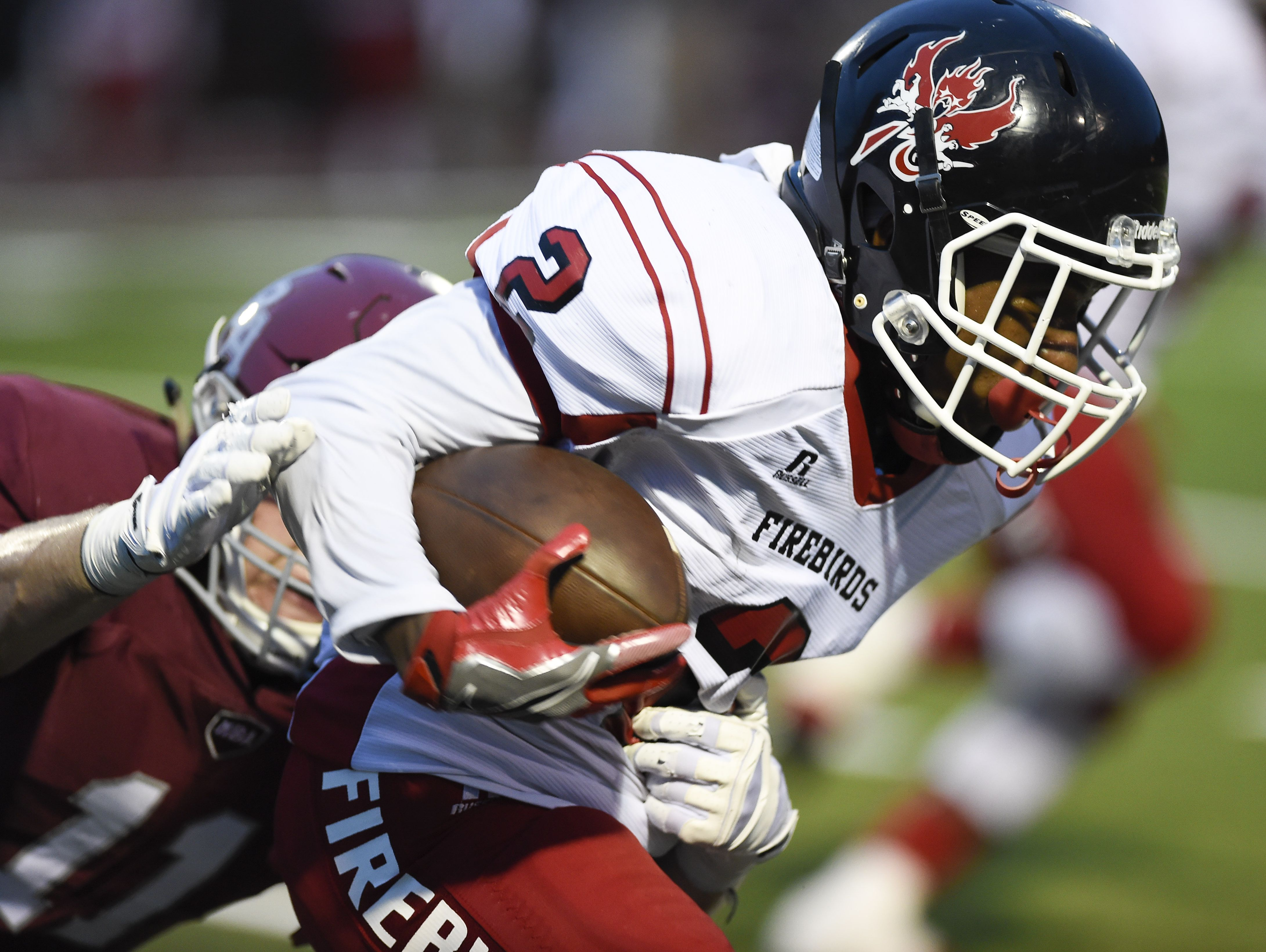 Pearl-Cohn running back Jimmyrious Parker (2) tries to get past MBA defensive back Gordon Pollock (11) during their game Friday Aug. 26, 2016, in Nashville, Tenn.
