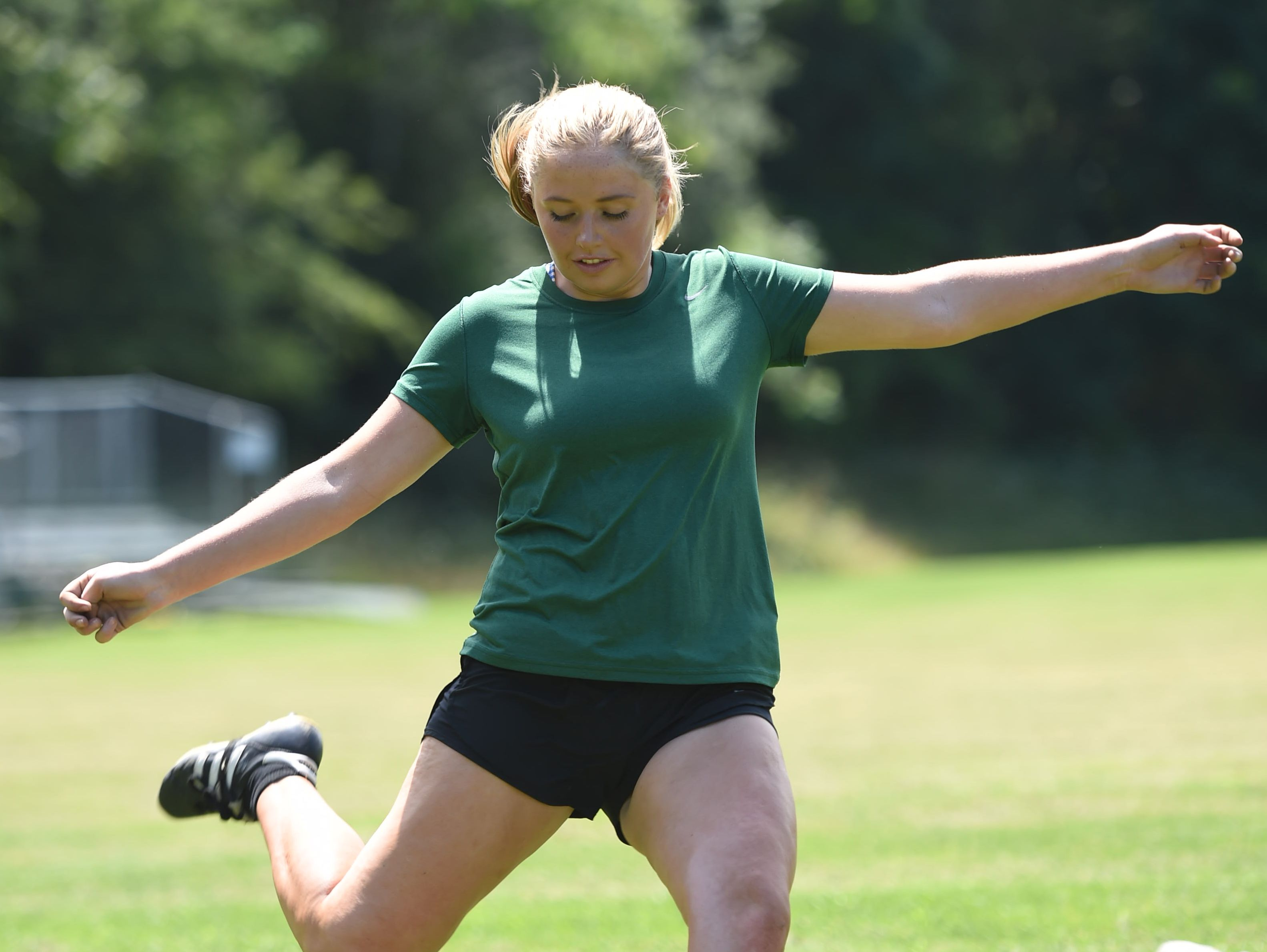 As part of her workout routine, Eileen Fiore practices shooting the ball at Spackenkill High School on Monday. Fiore tore her ACL during a playoff game against Dover High School on October 29, 2015.