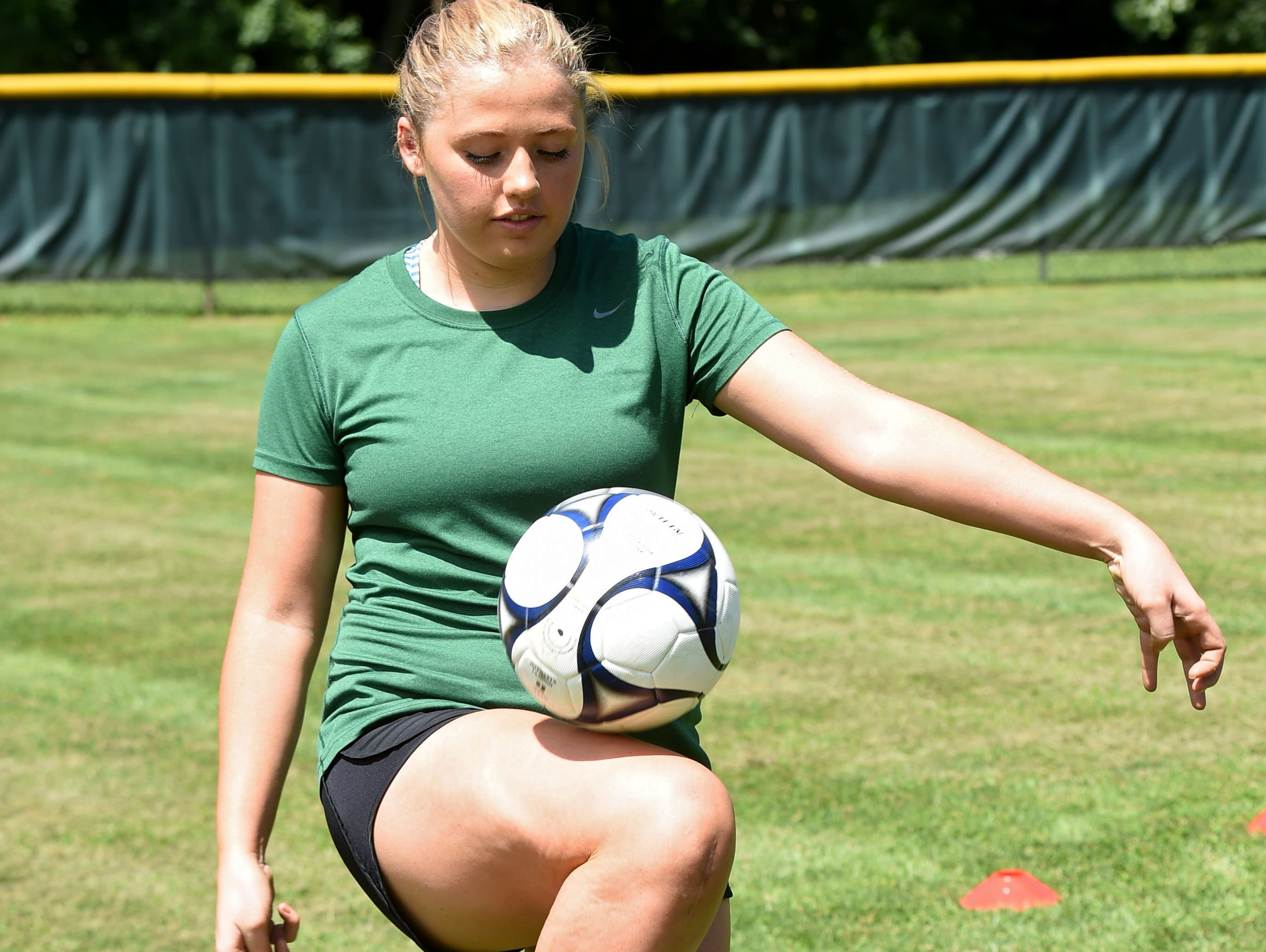 Eileen Fiore juggles a soccer ball while demonstrating her workout routine at Spackenkill High School in August. Fiore tore her ACL during a playoff game against Dover High School on October 29, 2015.