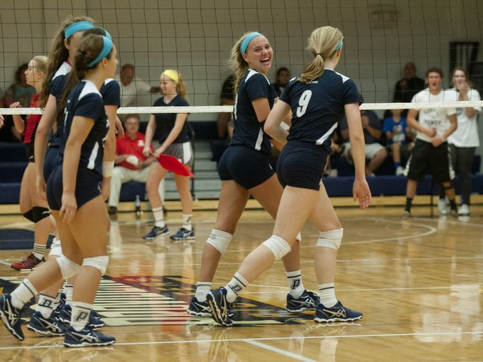 Providence senior setter Lexie Libs celebrates with her teammates after a win over New Albany earlier this season.