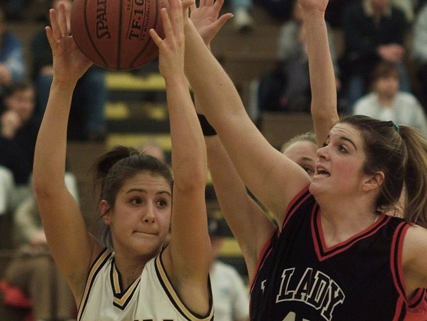Former Greece Athena forward Corrine Keller, left, during the Class A girls basketball state qualifier in 2003.