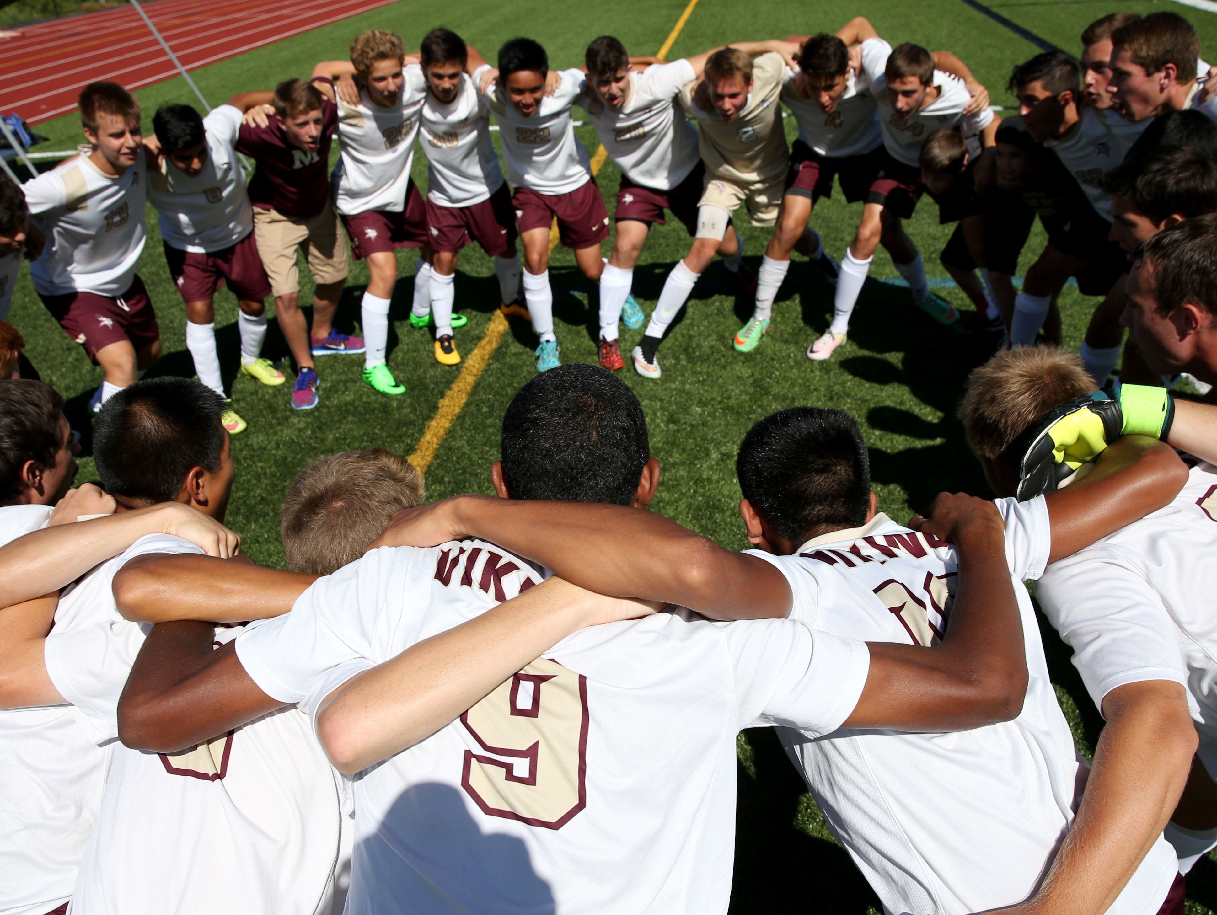 Adrian Padilla (9) and his Pittsford Mendon teammates get ready for the first game of the season against Aquinas.