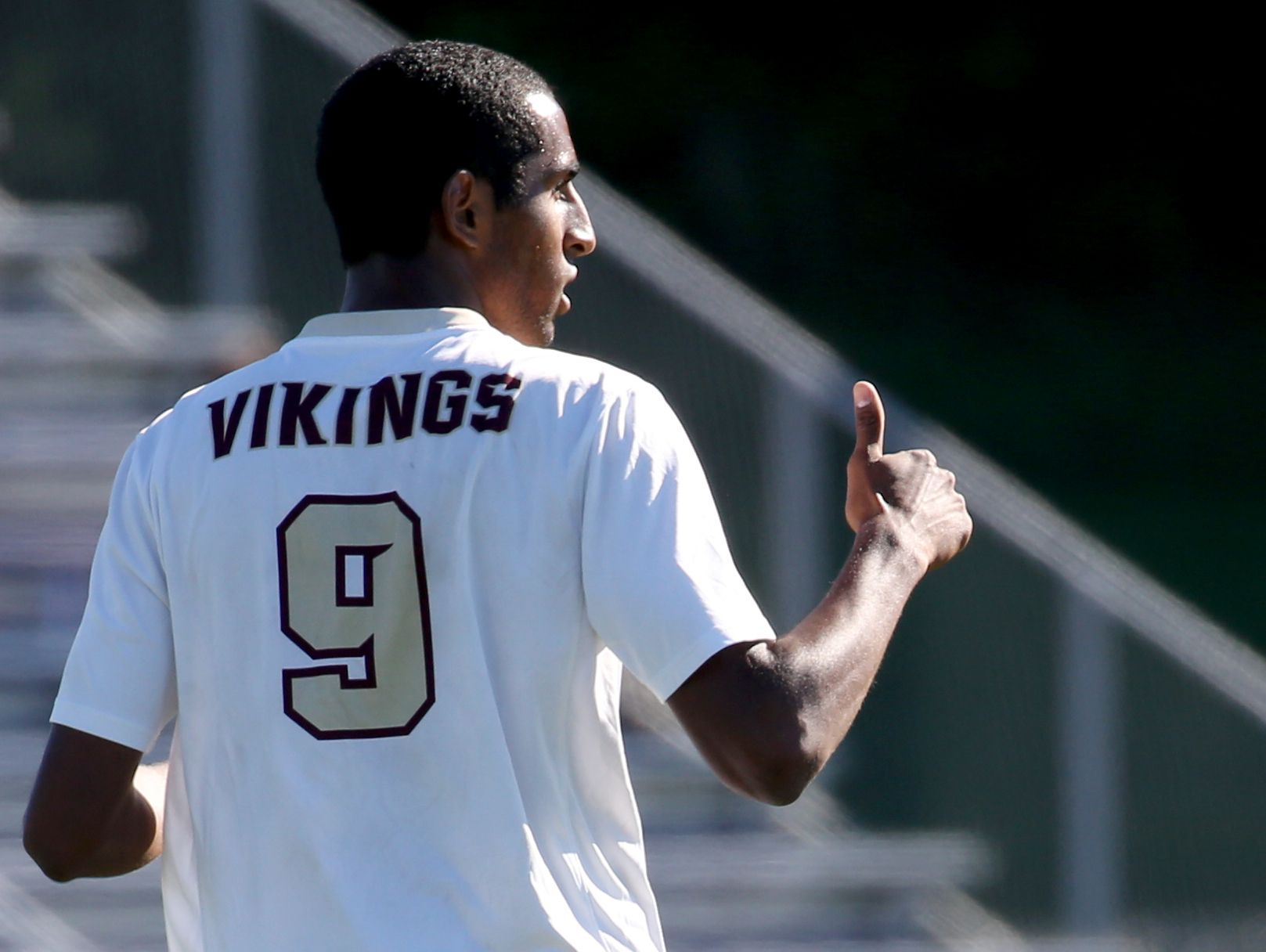 Adrian Padilla give a thumbs up to his coach Mark Hurley during the Pittsford Mendon soccer team's first game of the season against Aquinas. Padilla was chosen to wear the No. 9 Jersey of Honor this season.