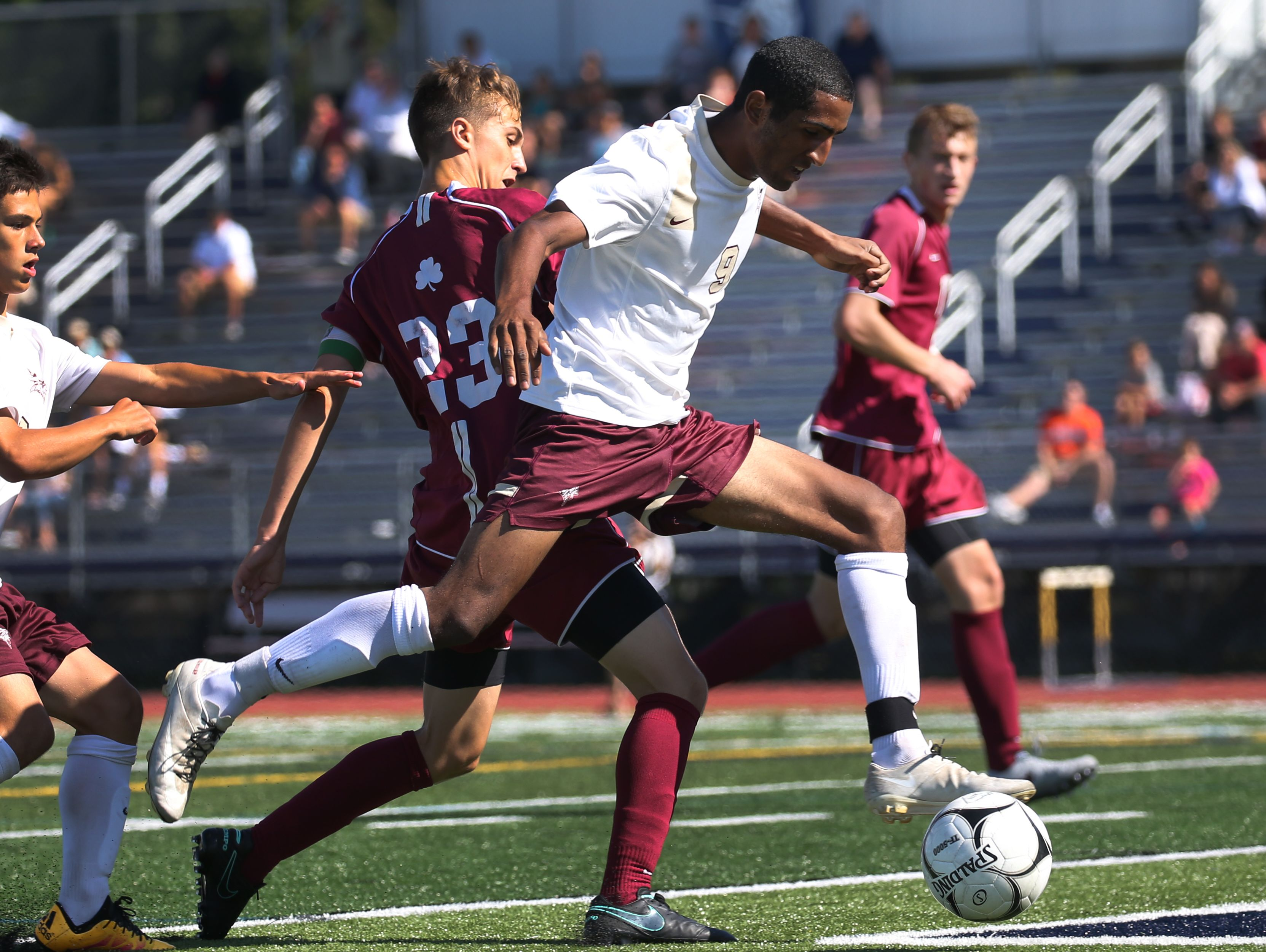 Adrian Padilla controls the ball for Pittsford Mendon during a season-opening win over Aquinas.