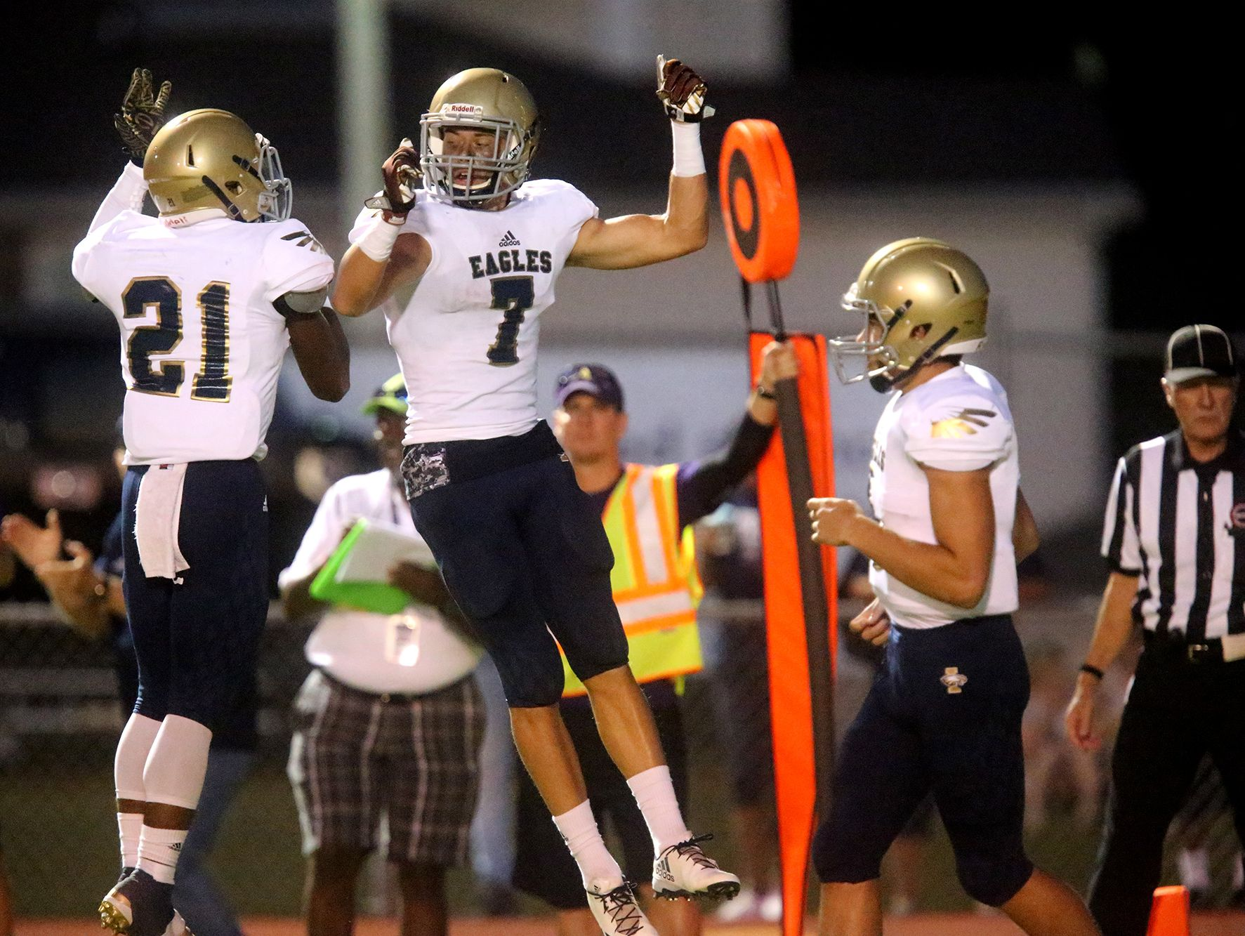Independence's Troy Henderson (21) and Landon Guidry (7) celebrate Guidry's touchdown against Smyrna, on Friday, Sept. 9, 2016, at Smyrna.