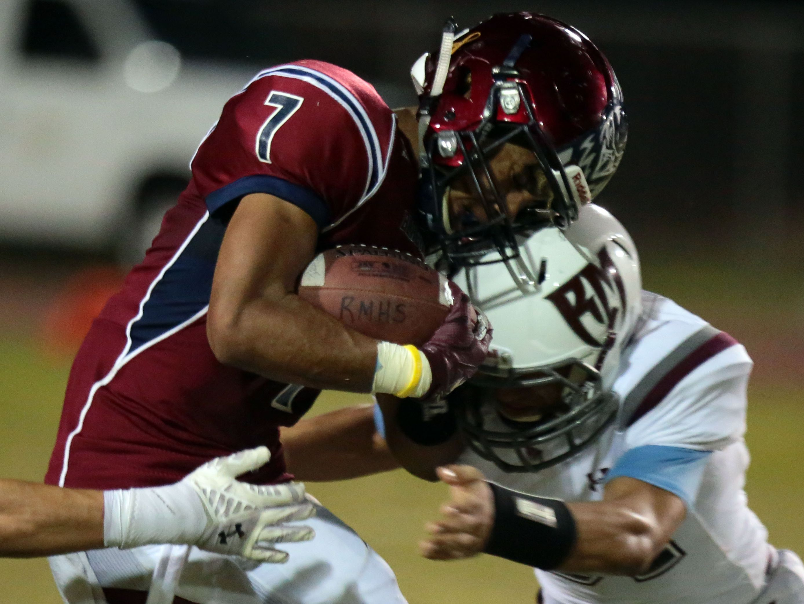 La Quinta's Justin Anderson carries the ball against Rancho Mirage on Friday, September 9, 2016 in La Quinta.