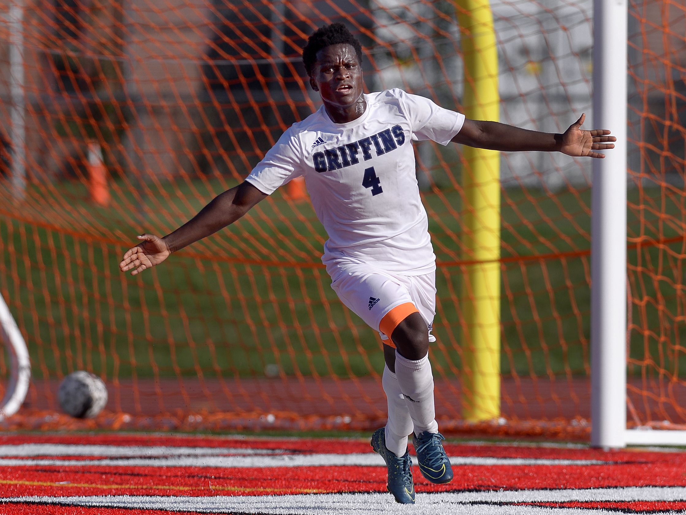 World of Inquiry's Toyi Hakizimana, a sophomore and two-time AGR pick, celebrates his goal against McQuaid in the Griffins' 2-1 overtime win on Sept. 21.