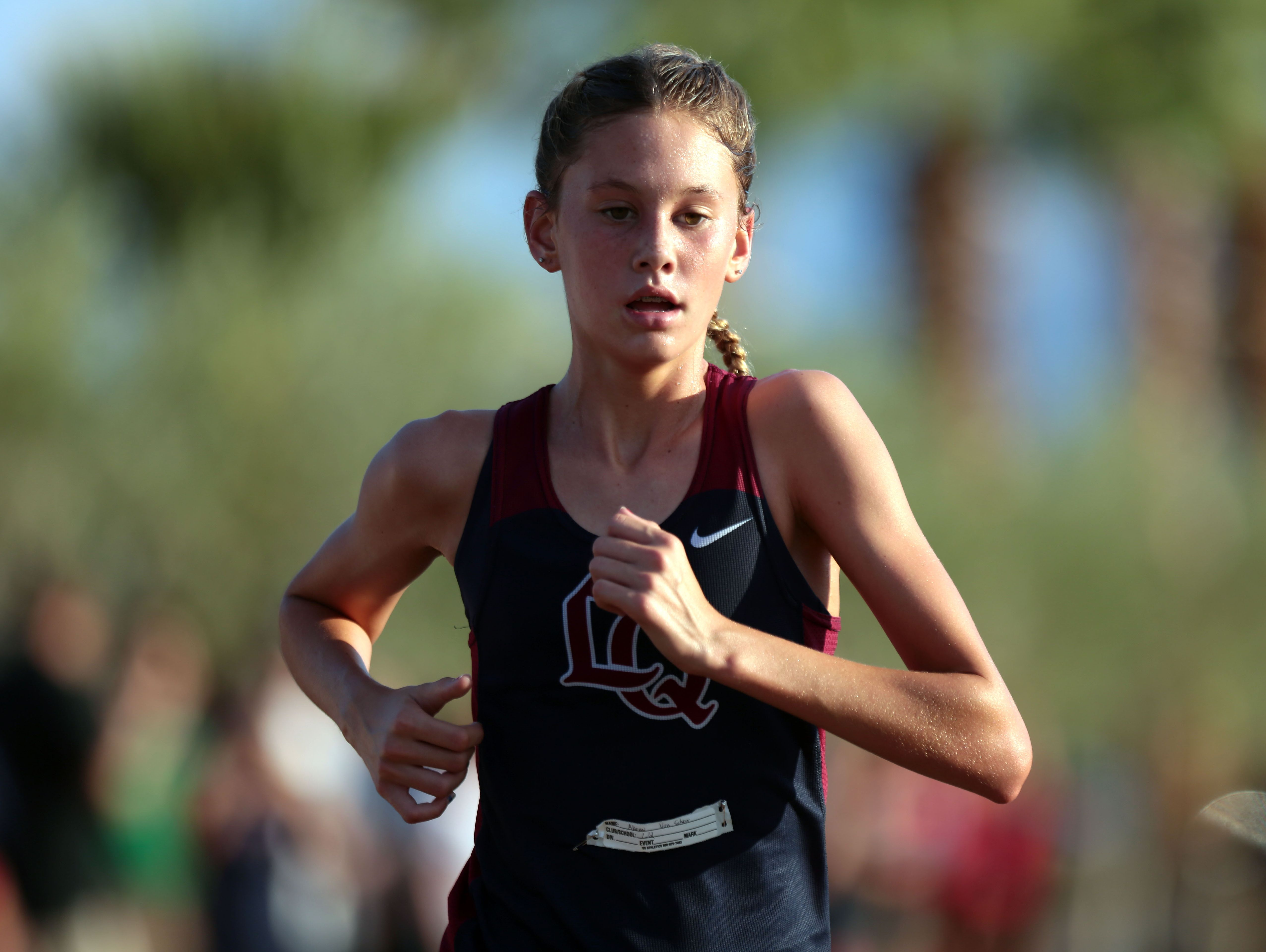 La Quinta's Akemi Von Schew is first in the girls' varsity race during the cross country meet at Xavier College Prep in Palm Desert on Wednesday, September 21, 2016.