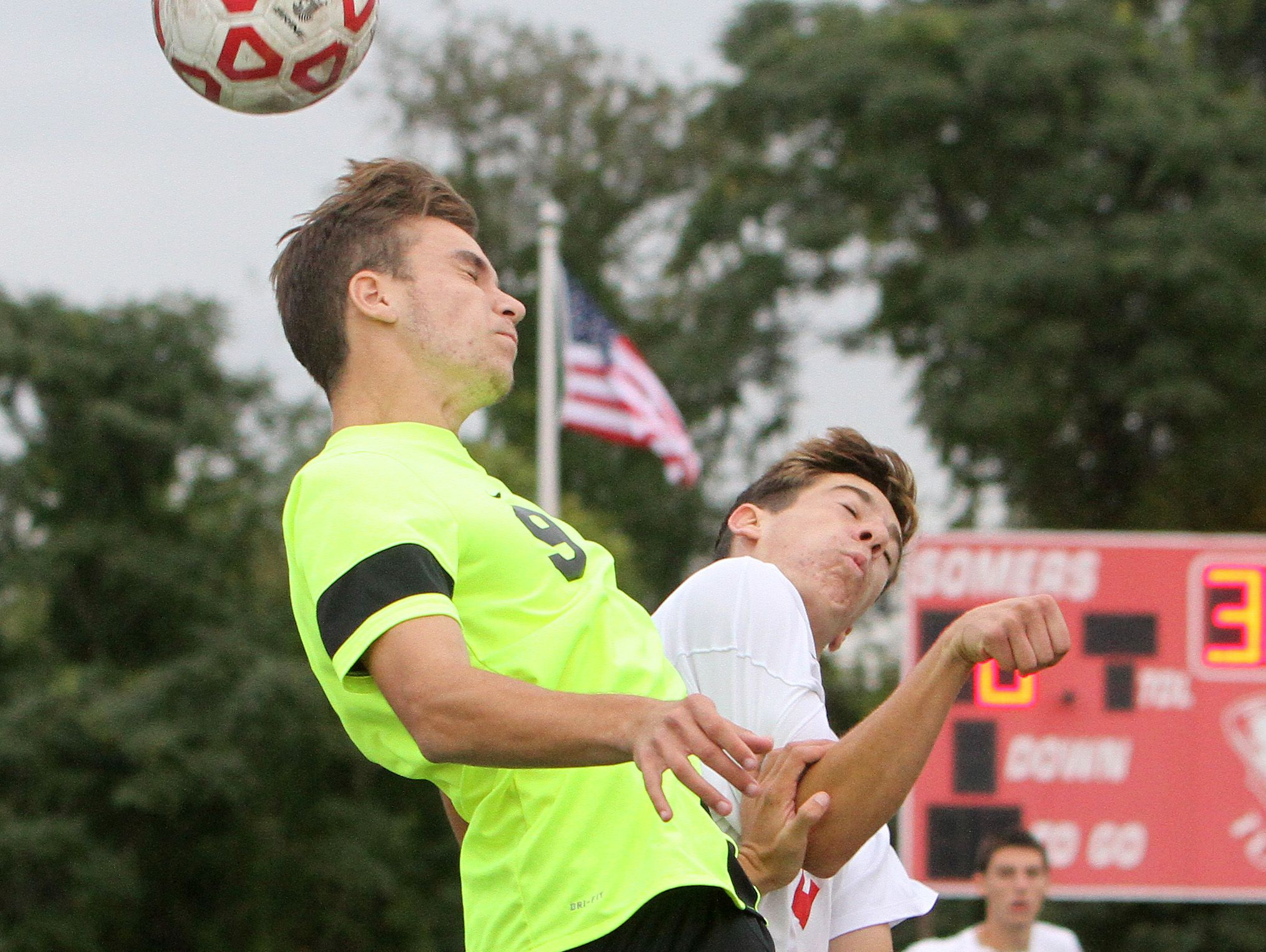 From left, Lakeland's Matias Prando (9) and Somers' Alex Elconin (12) battle for ball control during soccer action at Somers High School Sept. 28, 2016. Lakeland won the game 2-1 in overtime.