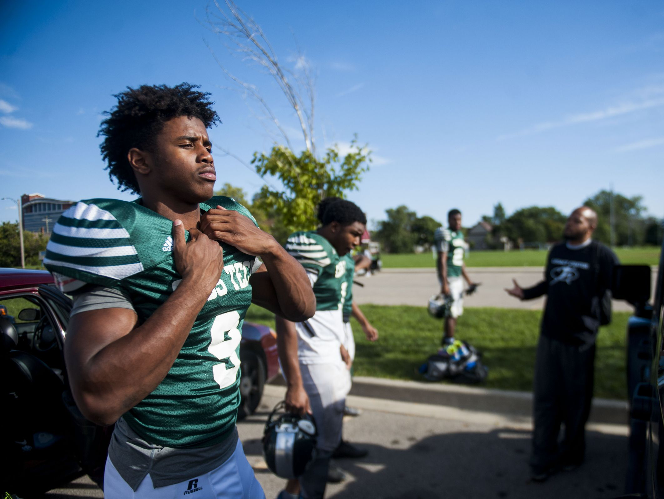 Cass Tech football player, Donovan Peoples-Jones checks his reflection in his Jeep window before the start of practice on Sept. 27, 2016.