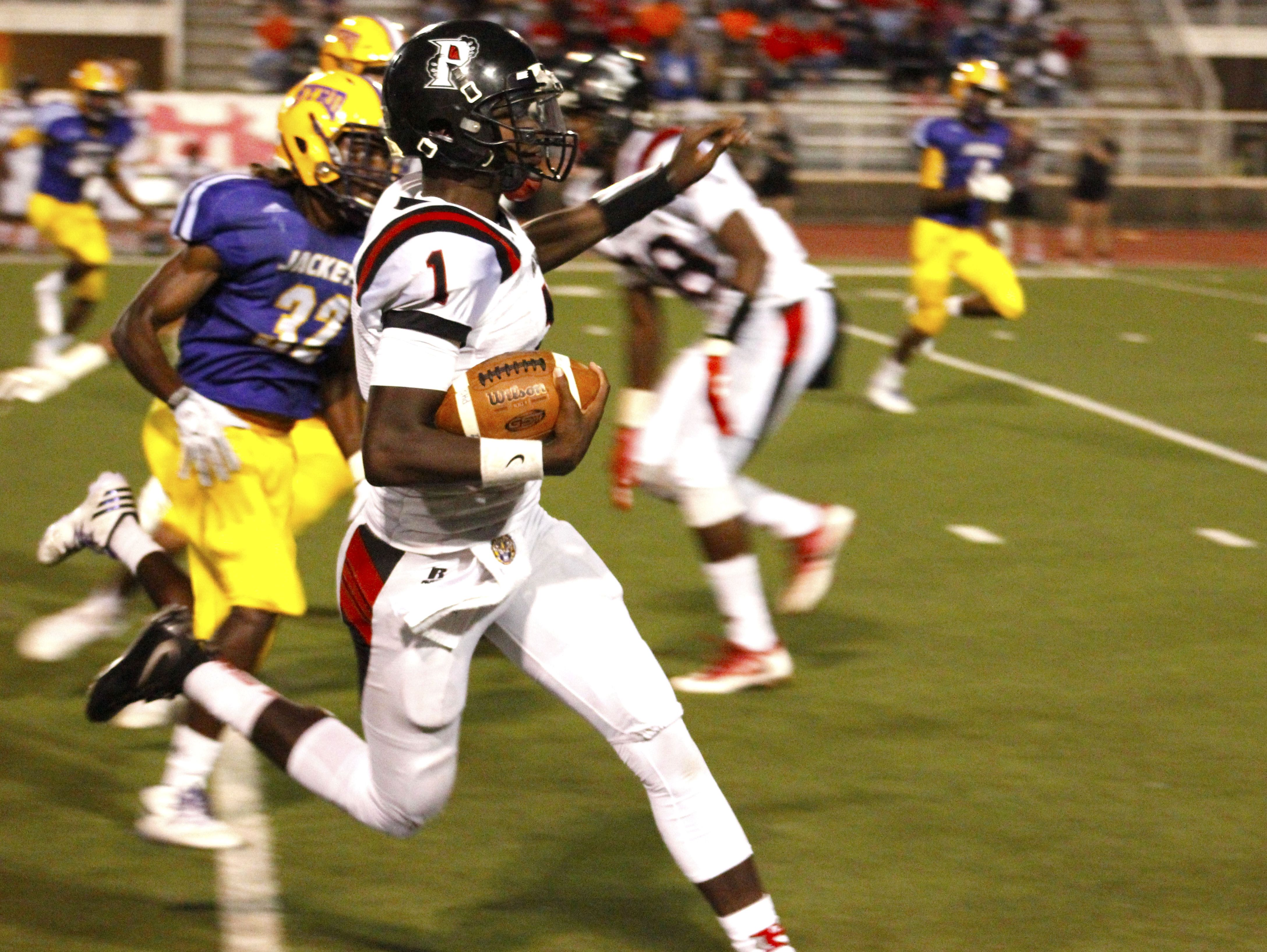 Parkway's Justin Rogers runs for yardage earlier this season against Byrd. Rogers leads the state in passing yards through 9 games.