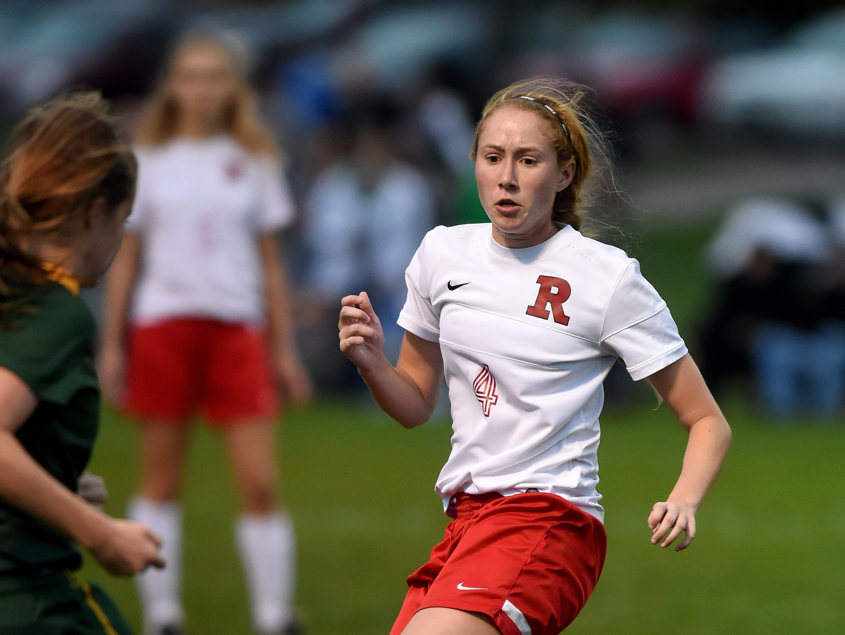 Richmond's Alexis Shiplett goes for the ball against Floyd Central Wednesday, Oct. 12, 2016 in the girls soccer regional game at East Central High School.
