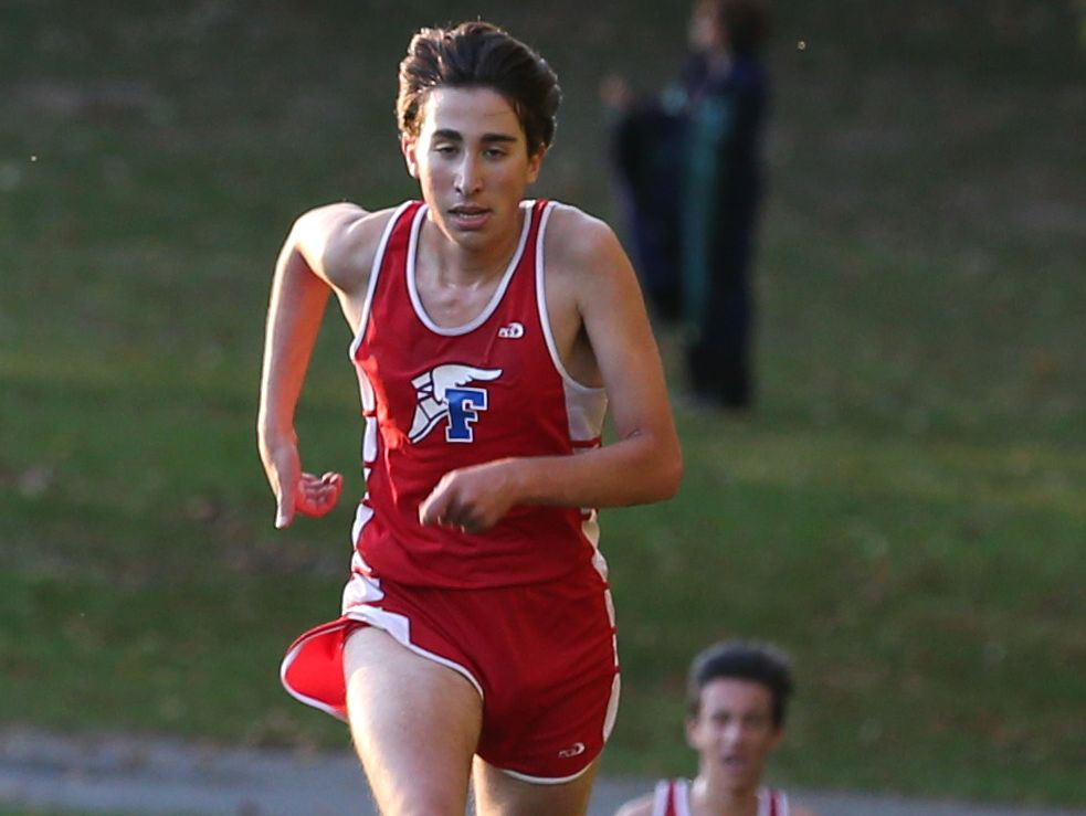 Majd Rovhana, Fairport, sprints the final stretch on his way to second place in the boys race.
