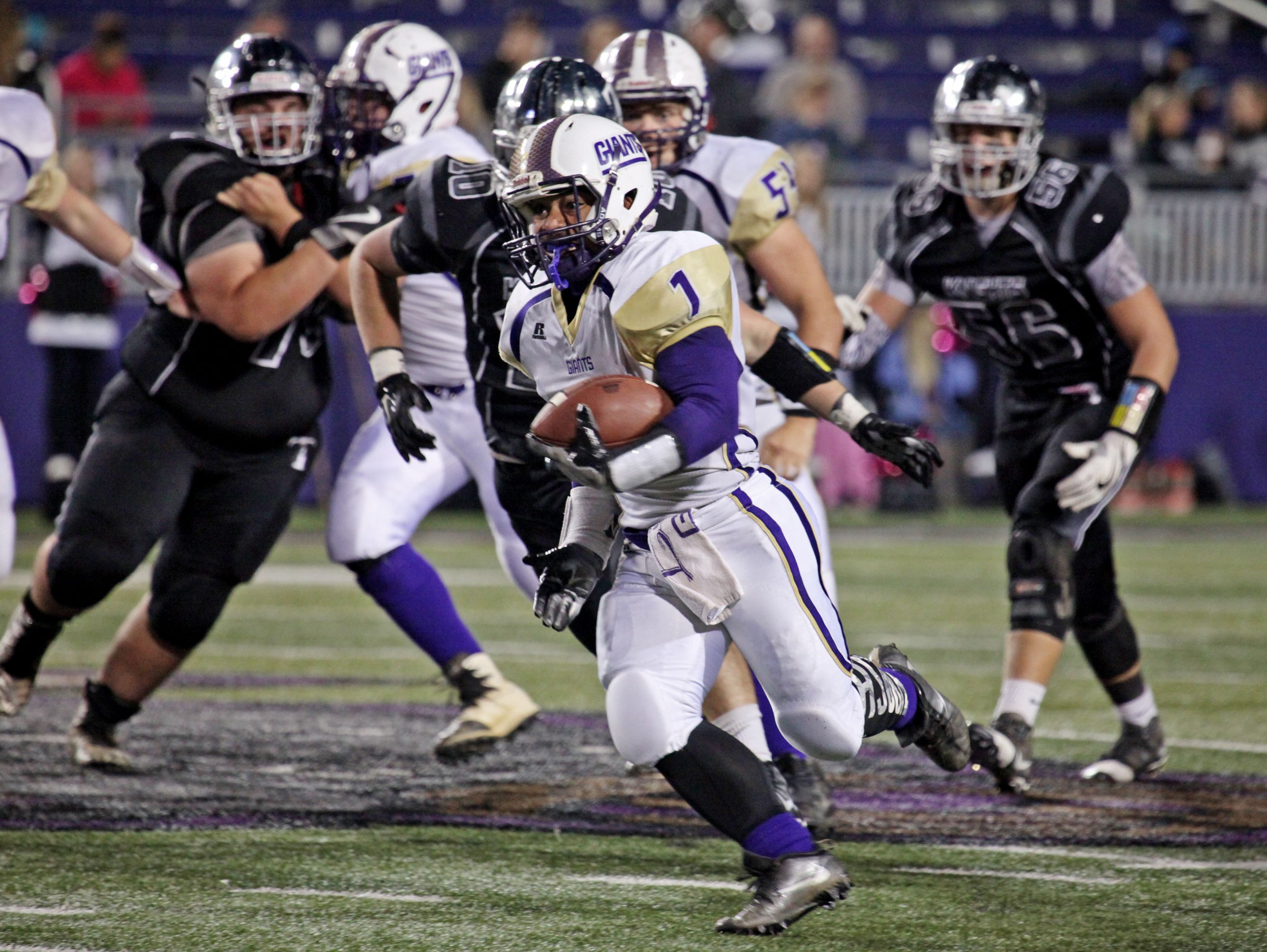 Waynesboro's Marendon Jones runs the ball in for a touchdown during the first half of the game against Turner Ashby on Friday, Oct. 14, 2016 at James Madison University's Bridgeforth Stadium in Harrisonburg.