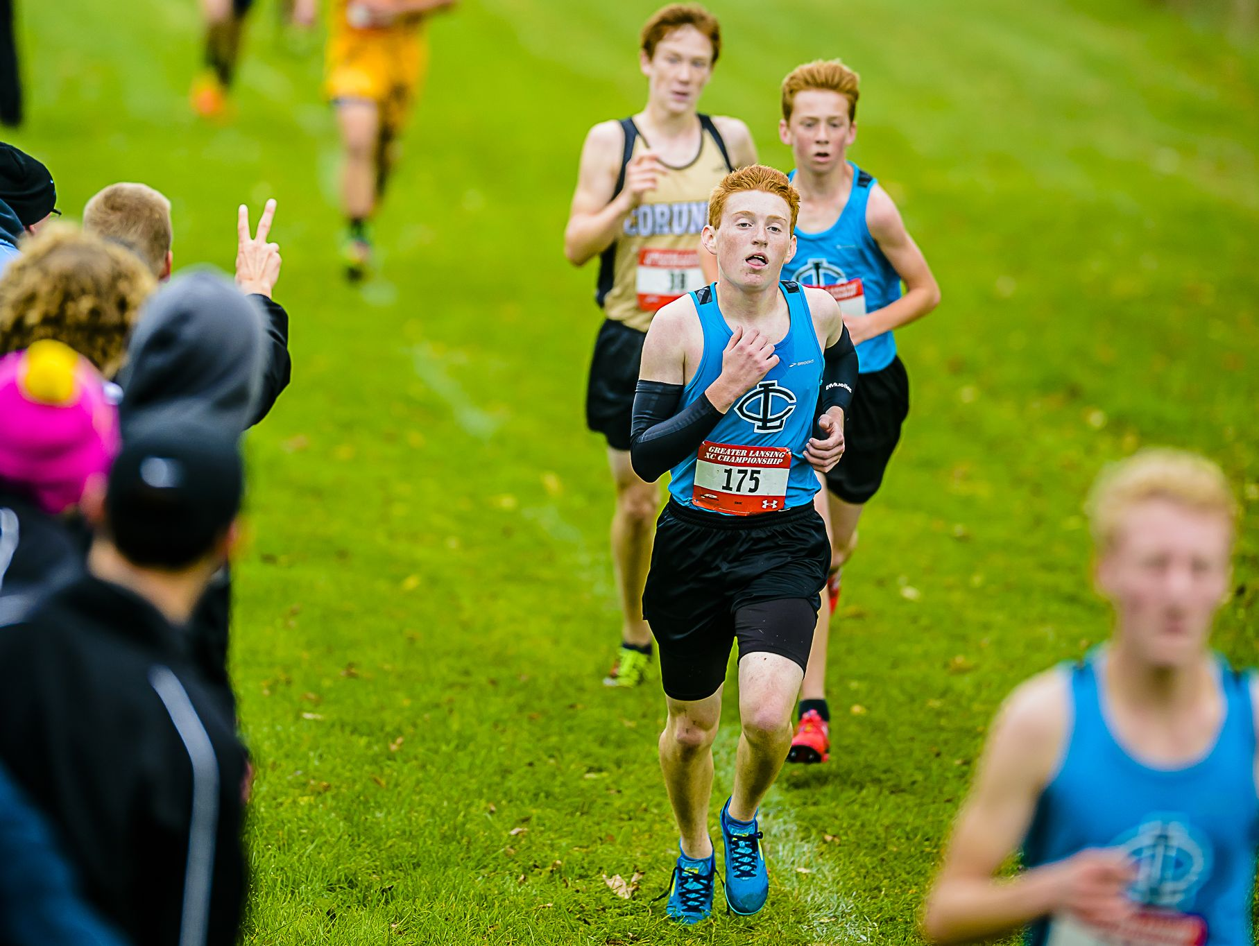 Eric Warriner ,175, of Lansing Catholic runs during the Greater Lansing Cross Country championships Saturday October 15, 2016 at Ledge Meadows Golf Course. Warriner and the Cougars will be trying to repeat as Division 3 state champions Saturday.